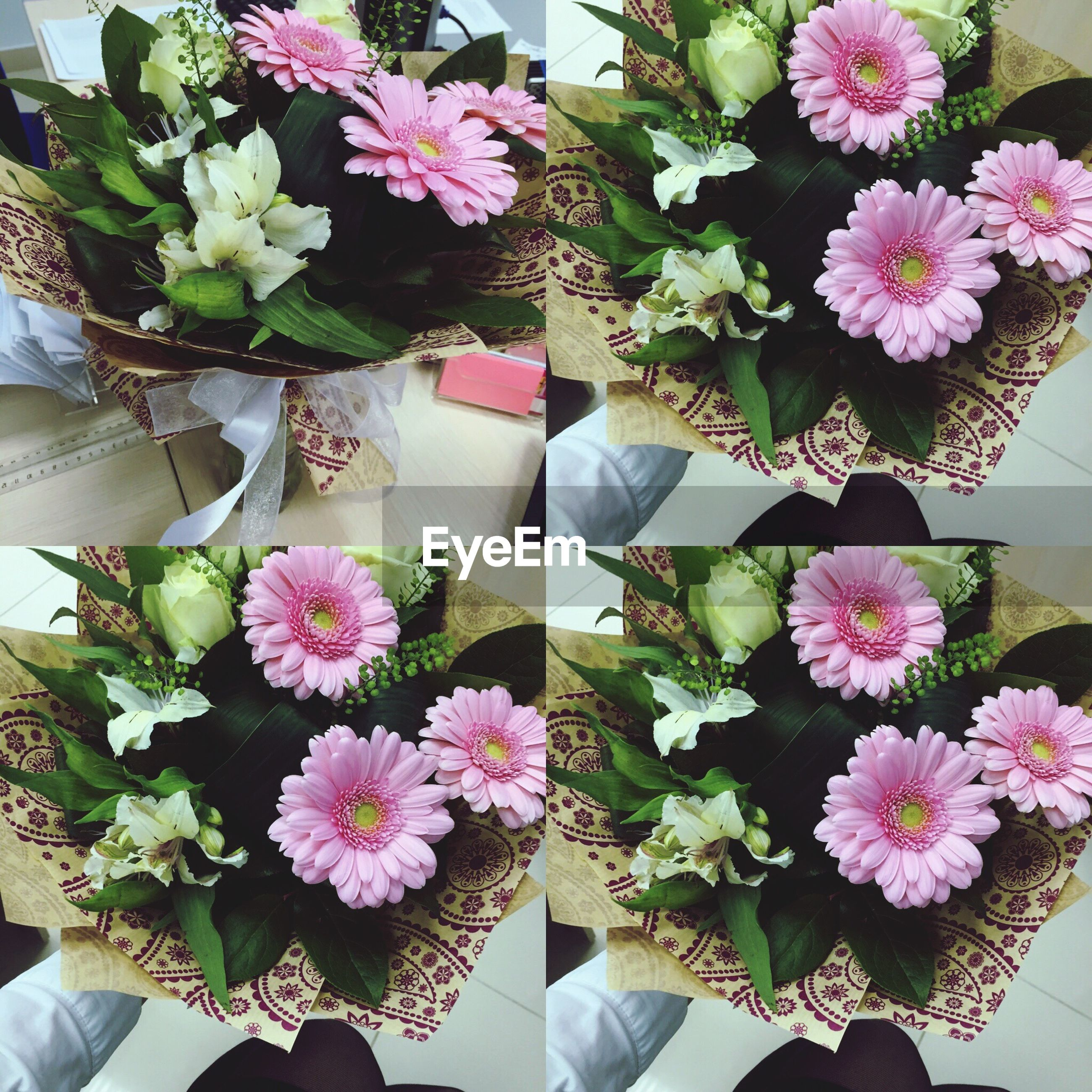 flower, indoors, freshness, vase, fragility, table, petal, potted plant, high angle view, growth, bunch of flowers, bouquet, flower arrangement, plant, variation, flower head, flower pot, leaf, beauty in nature, pink color