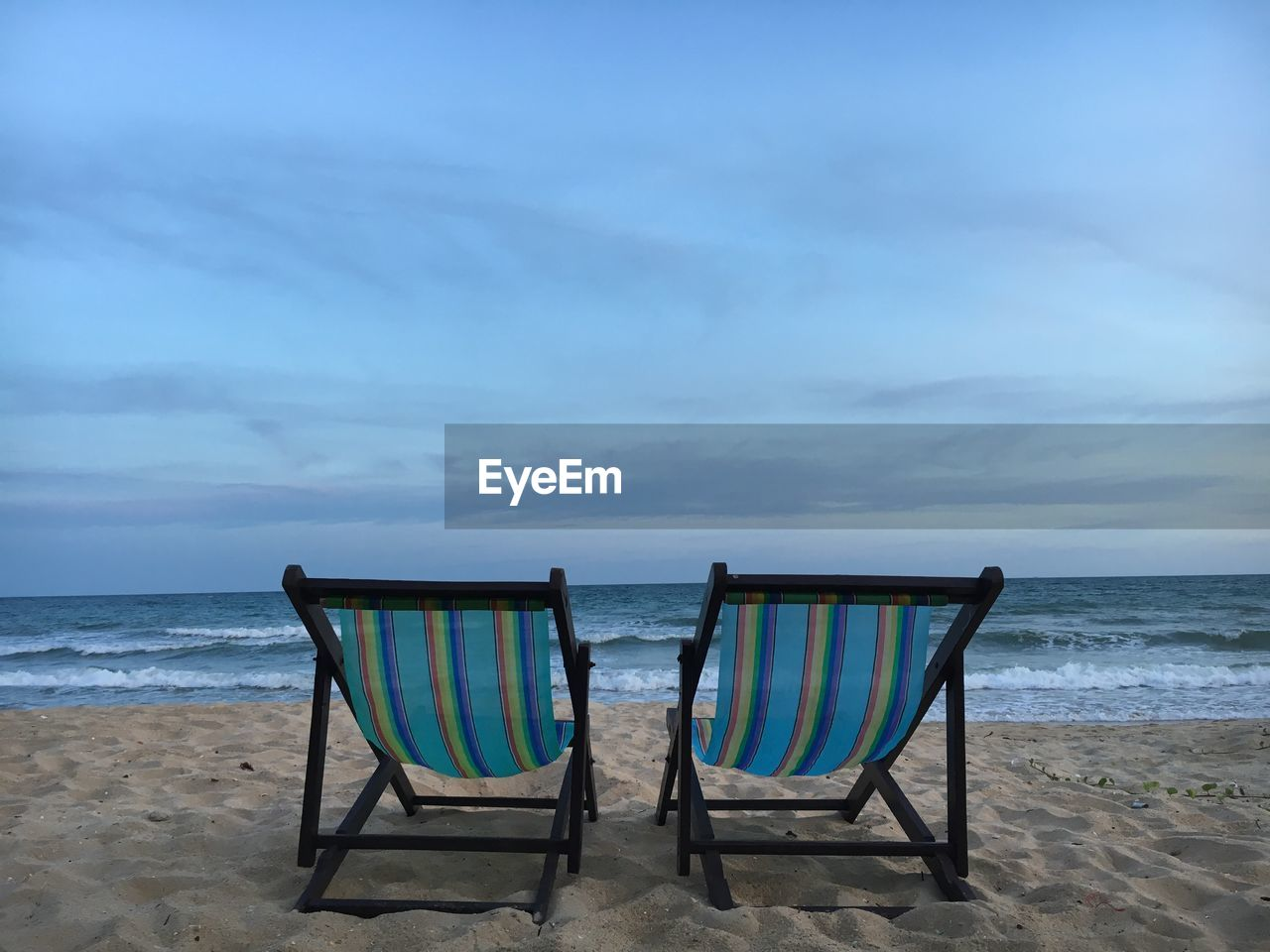 beach, sea, water, land, cloud - sky, sky, horizon, horizon over water, scenics - nature, beauty in nature, sand, tranquility, chair, seat, tranquil scene, nature, absence, idyllic, day, outdoors, no people, outdoor chair