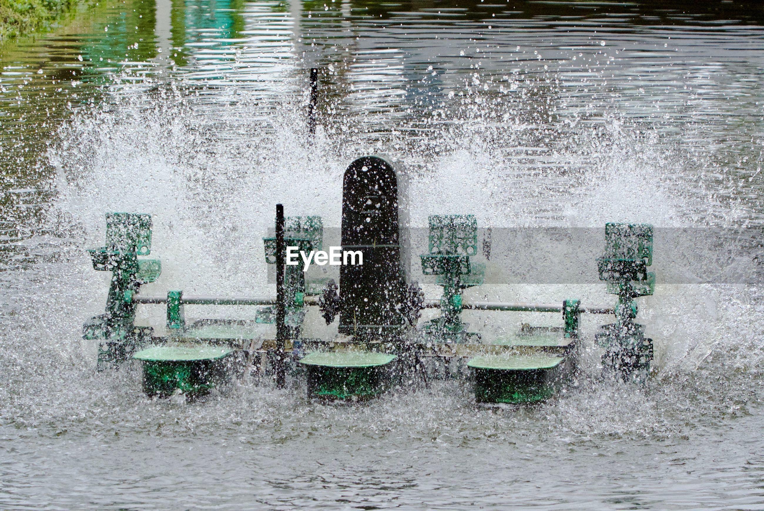Machinery splashing water in lake