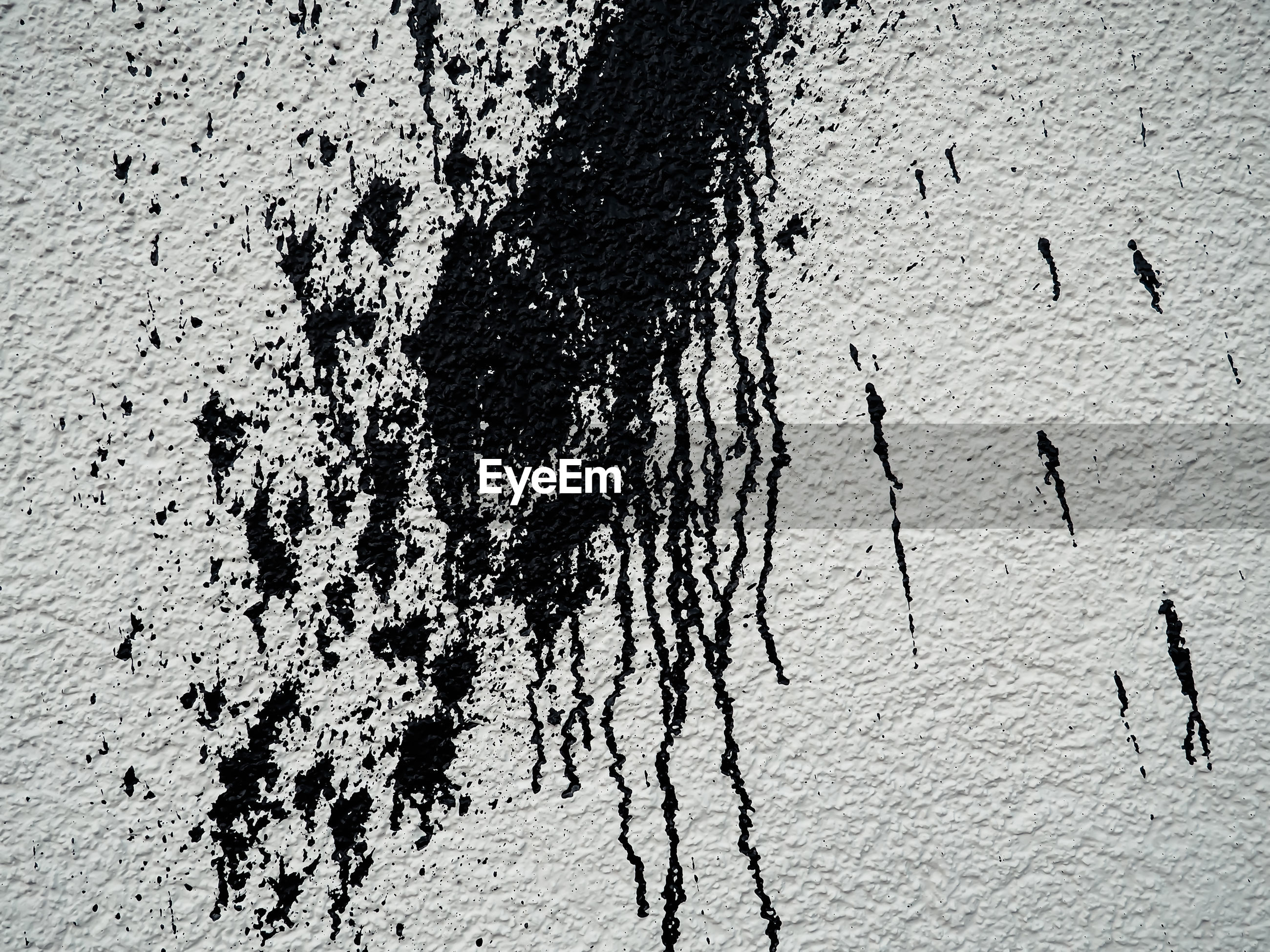 Close-up of spilled paint on wall