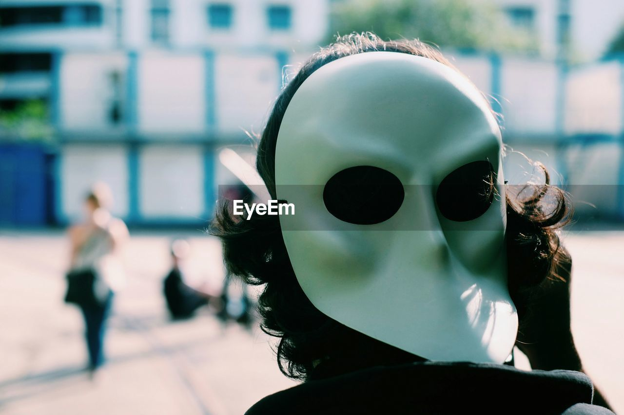 Rear View Of Person Wearing Mask