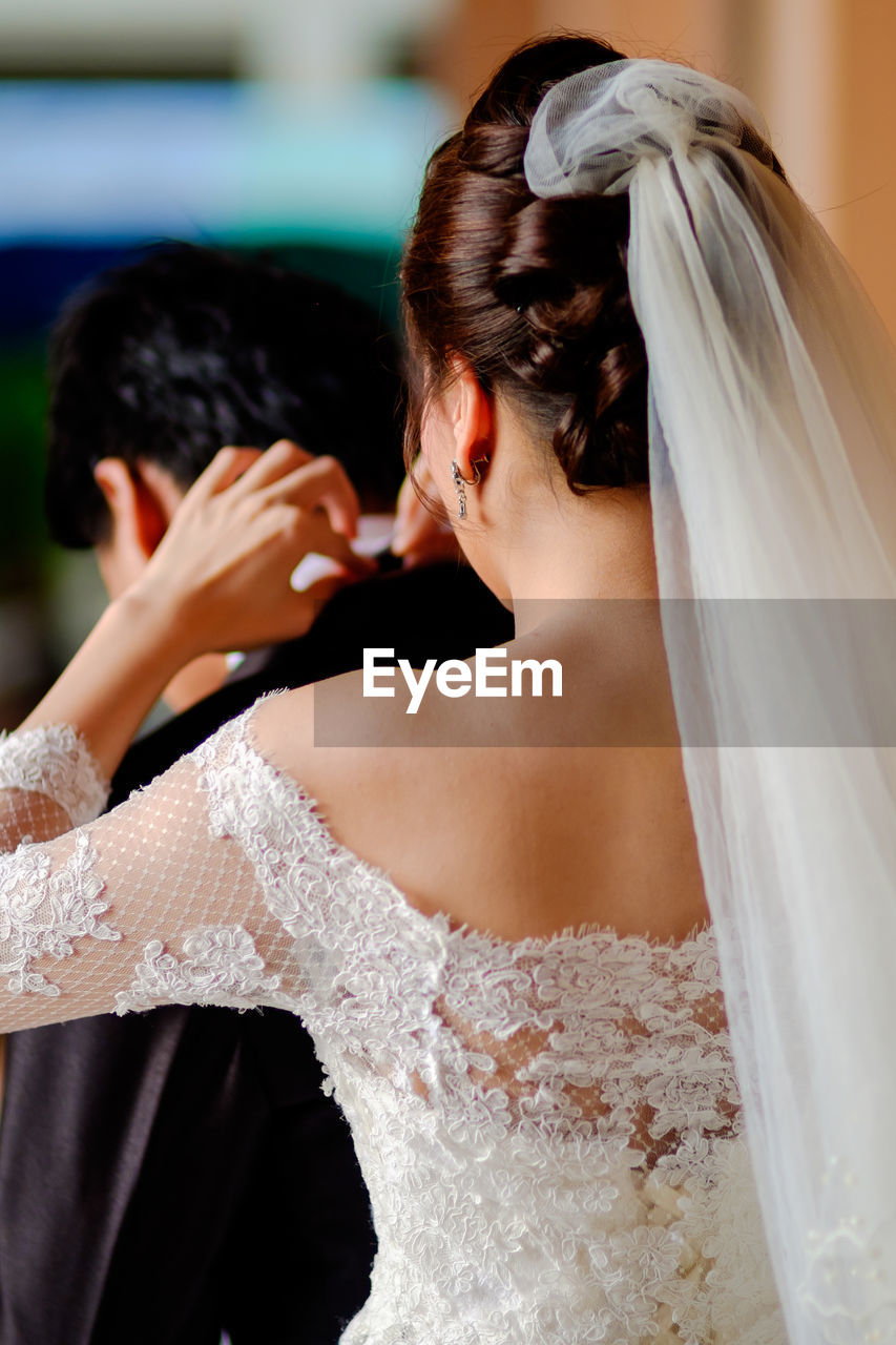 newlywed, bride, wedding, event, wedding dress, women, celebration, adult, life events, veil, real people, focus on foreground, two people, portrait, married, young adult, emotion, indoors, young women, beautiful woman, positive emotion, wife, couple - relationship, hairstyle, wedding ceremony