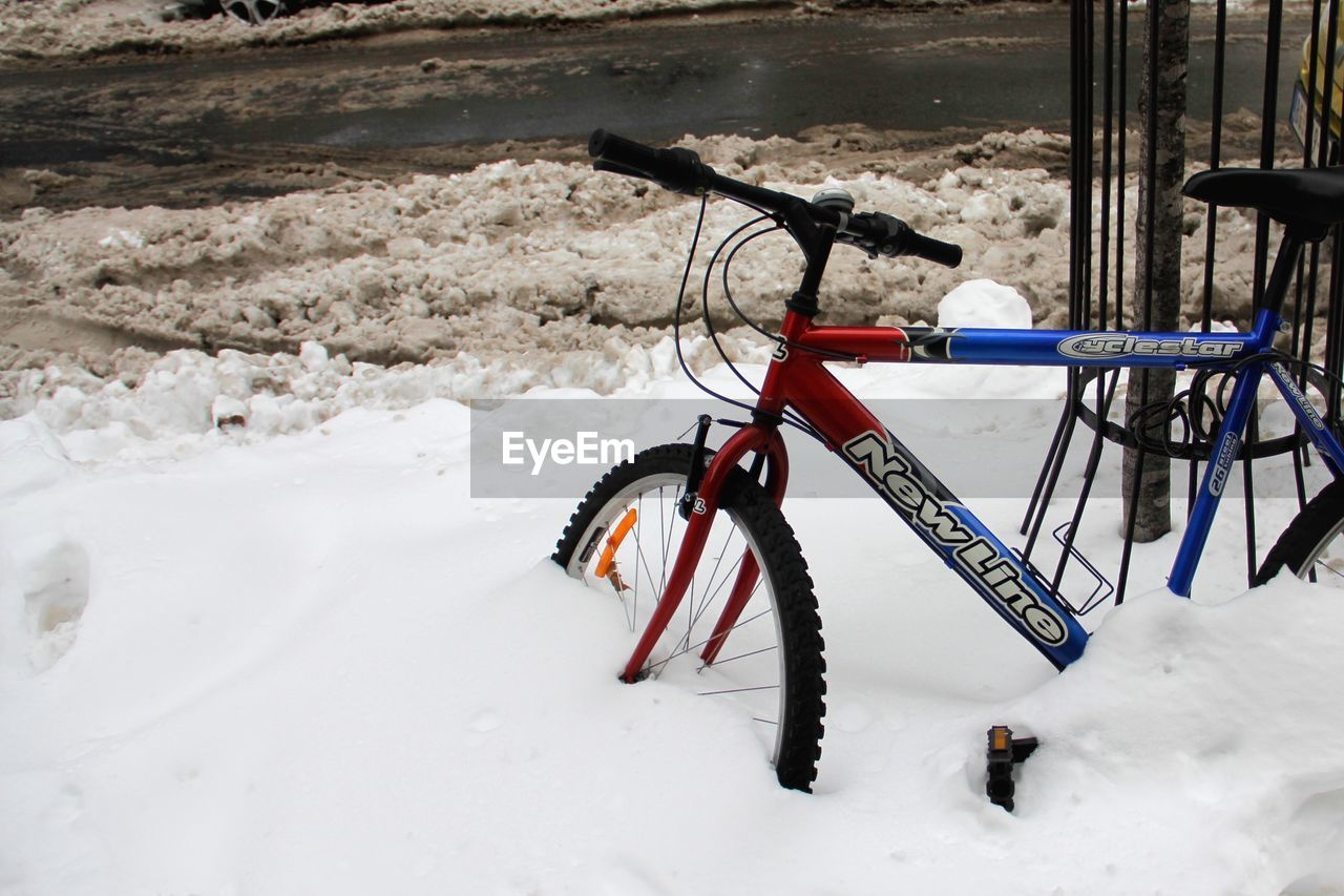 winter, snow, bicycle, cold temperature, land, stationary, field, white color, nature, day, covering, land vehicle, transportation, no people, mode of transportation, outdoors, frozen, parking, absence, wheel
