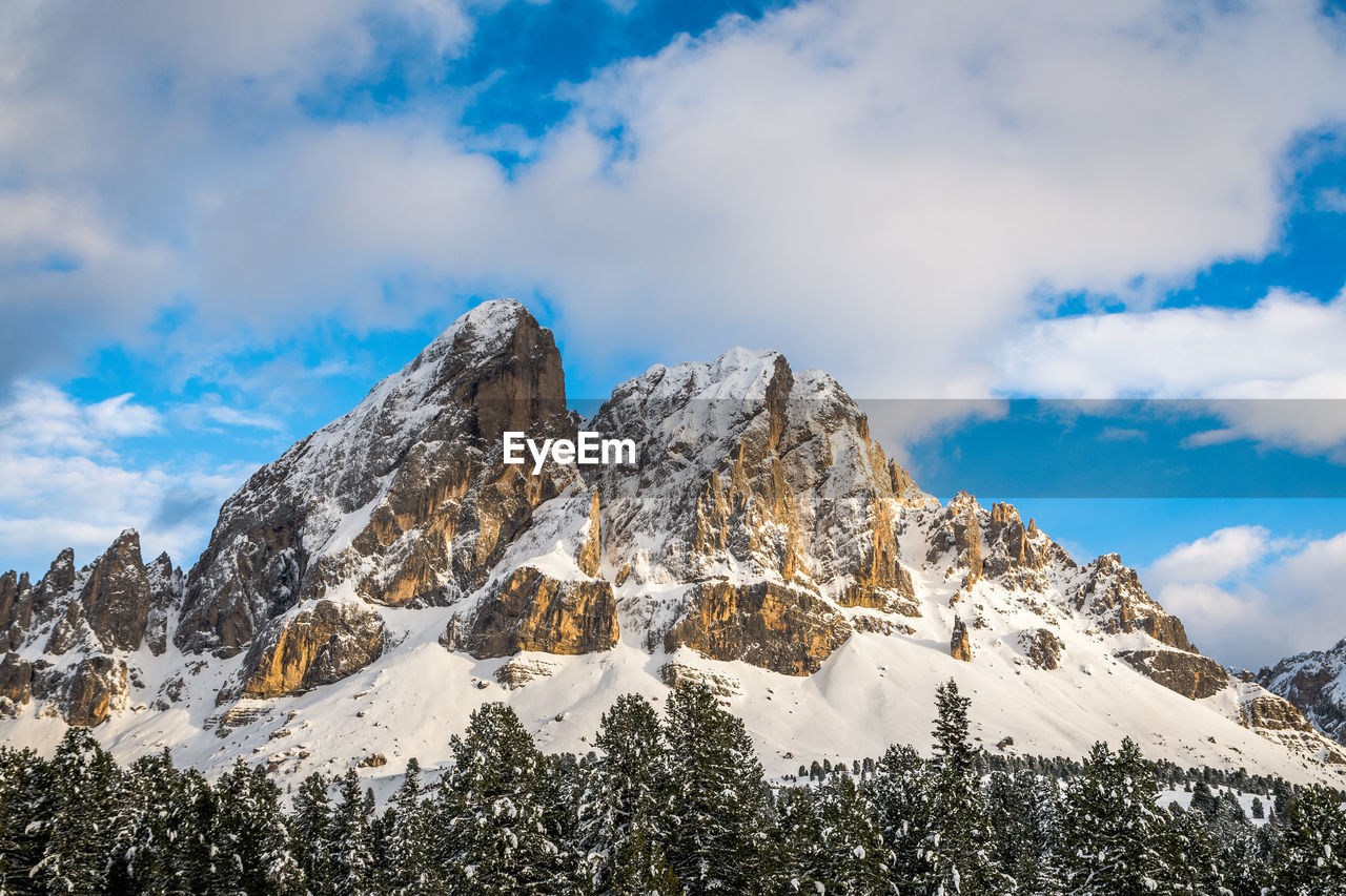 snow, sky, cloud - sky, winter, cold temperature, beauty in nature, scenics - nature, mountain, tranquil scene, tranquility, low angle view, plant, nature, tree, non-urban scene, no people, idyllic, solid, rock, snowcapped mountain, mountain range, mountain peak, outdoors, formation, coniferous tree