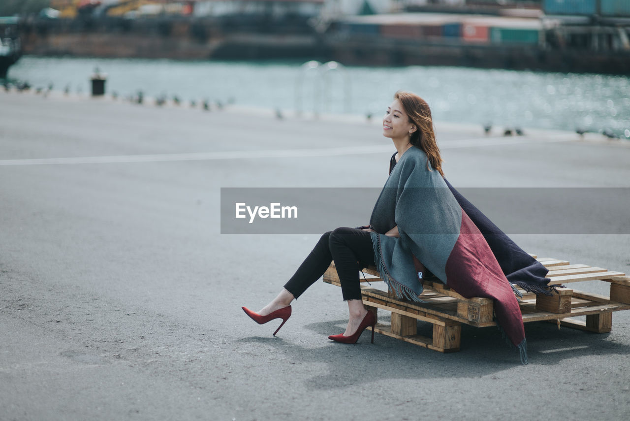 Woman Sitting On Pallets