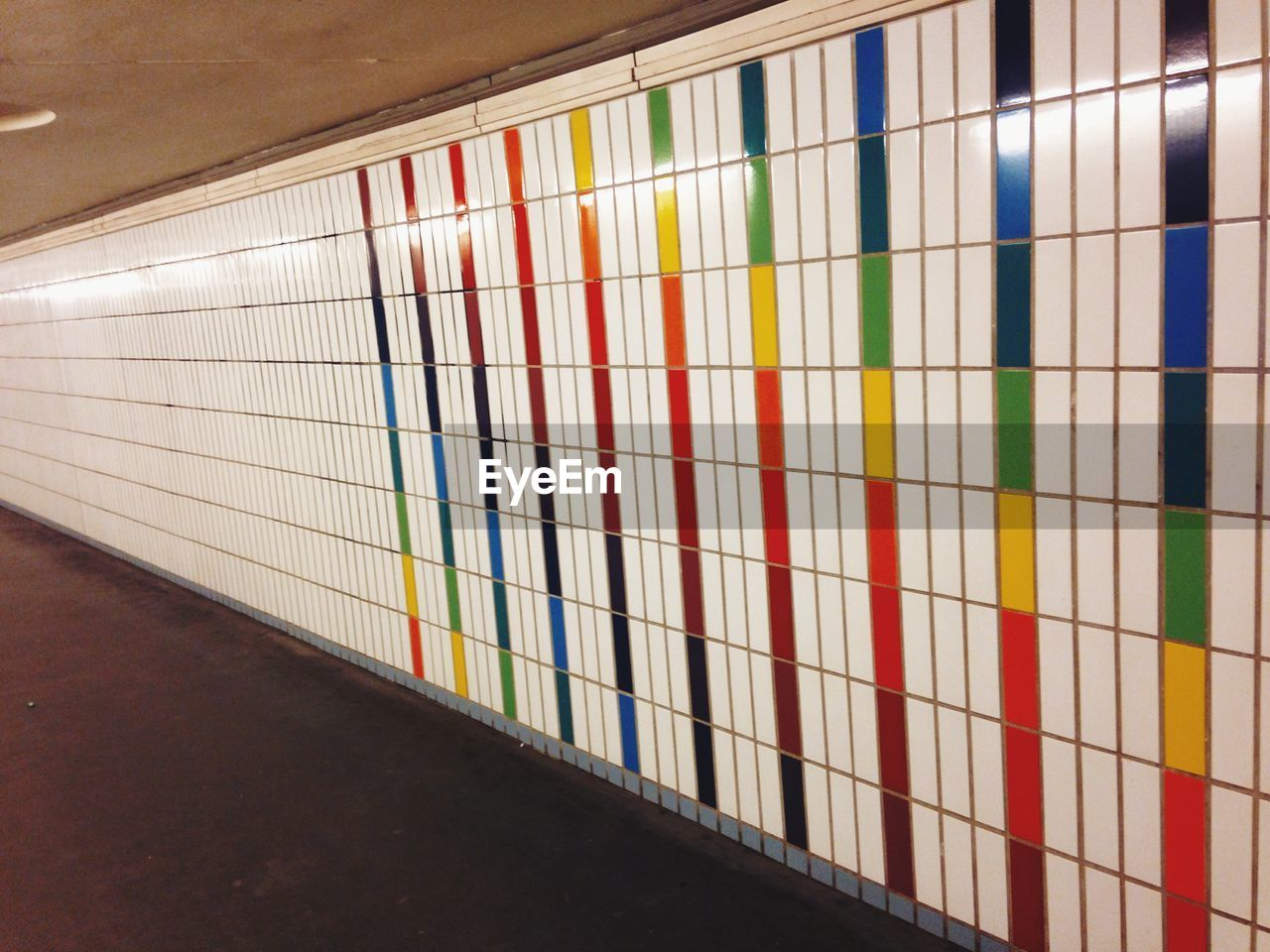 Multicolored lines on tiled wall