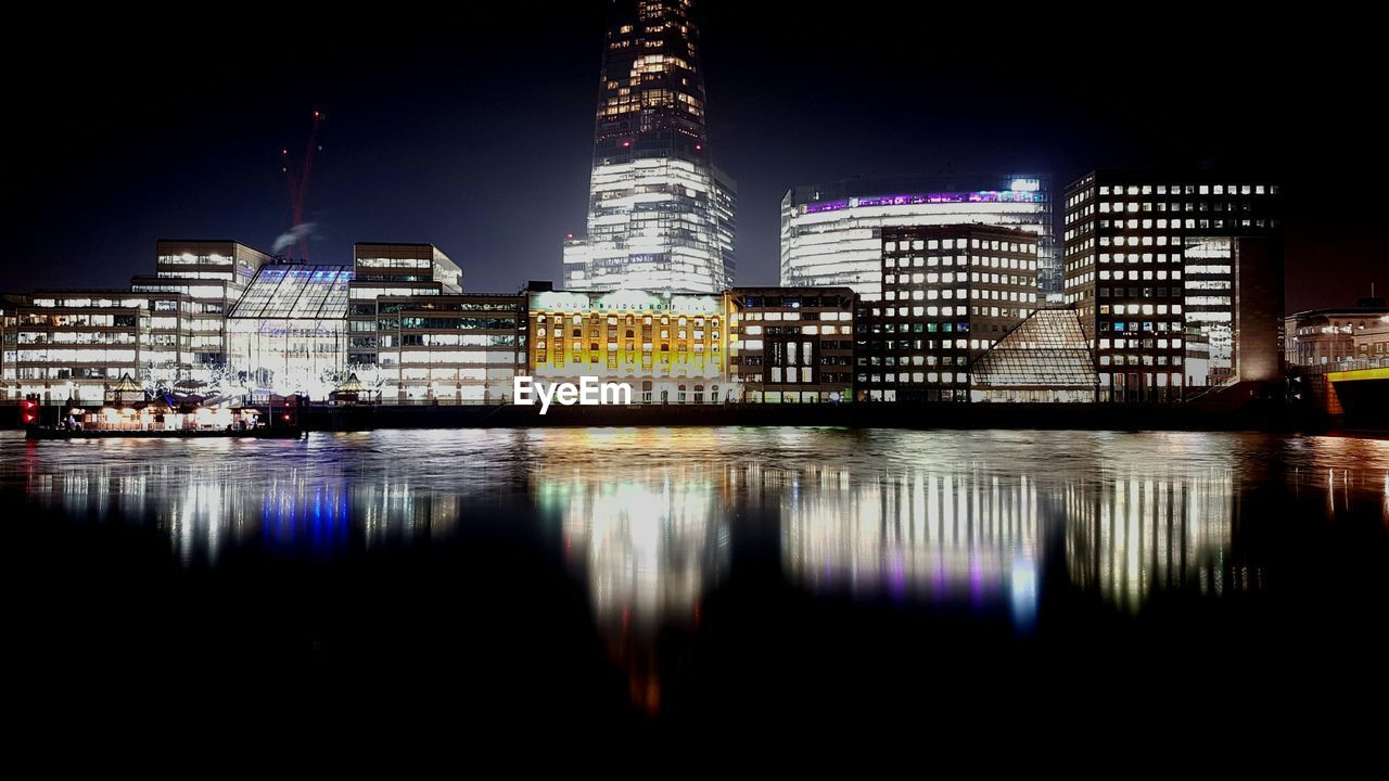 architecture, reflection, illuminated, built structure, building exterior, waterfront, night, water, travel destinations, skyscraper, modern, city, no people, outdoors, sky