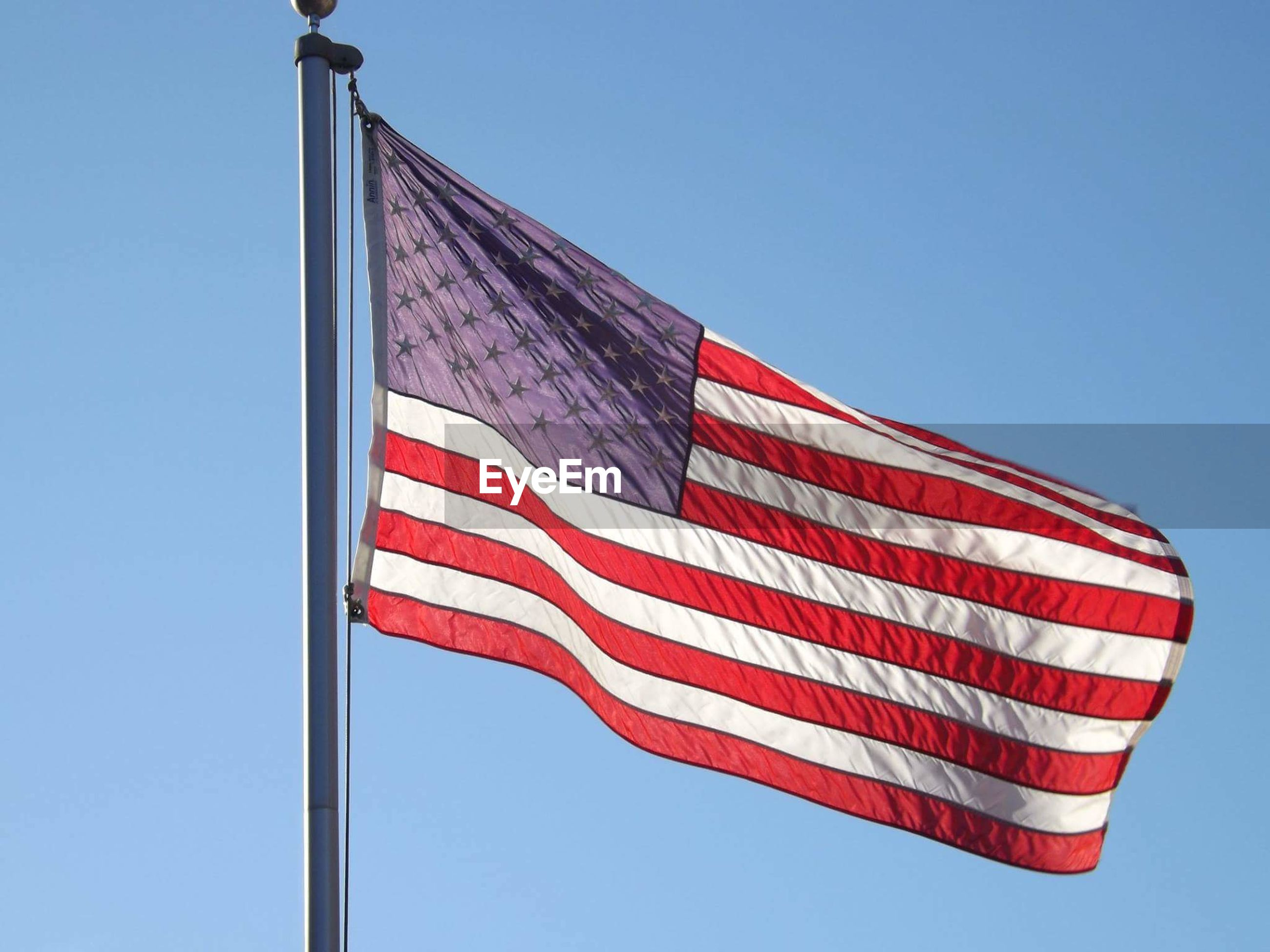 low angle view, clear sky, patriotism, flag, striped, blue, red, no people, sky, day, outdoors, stars and stripes
