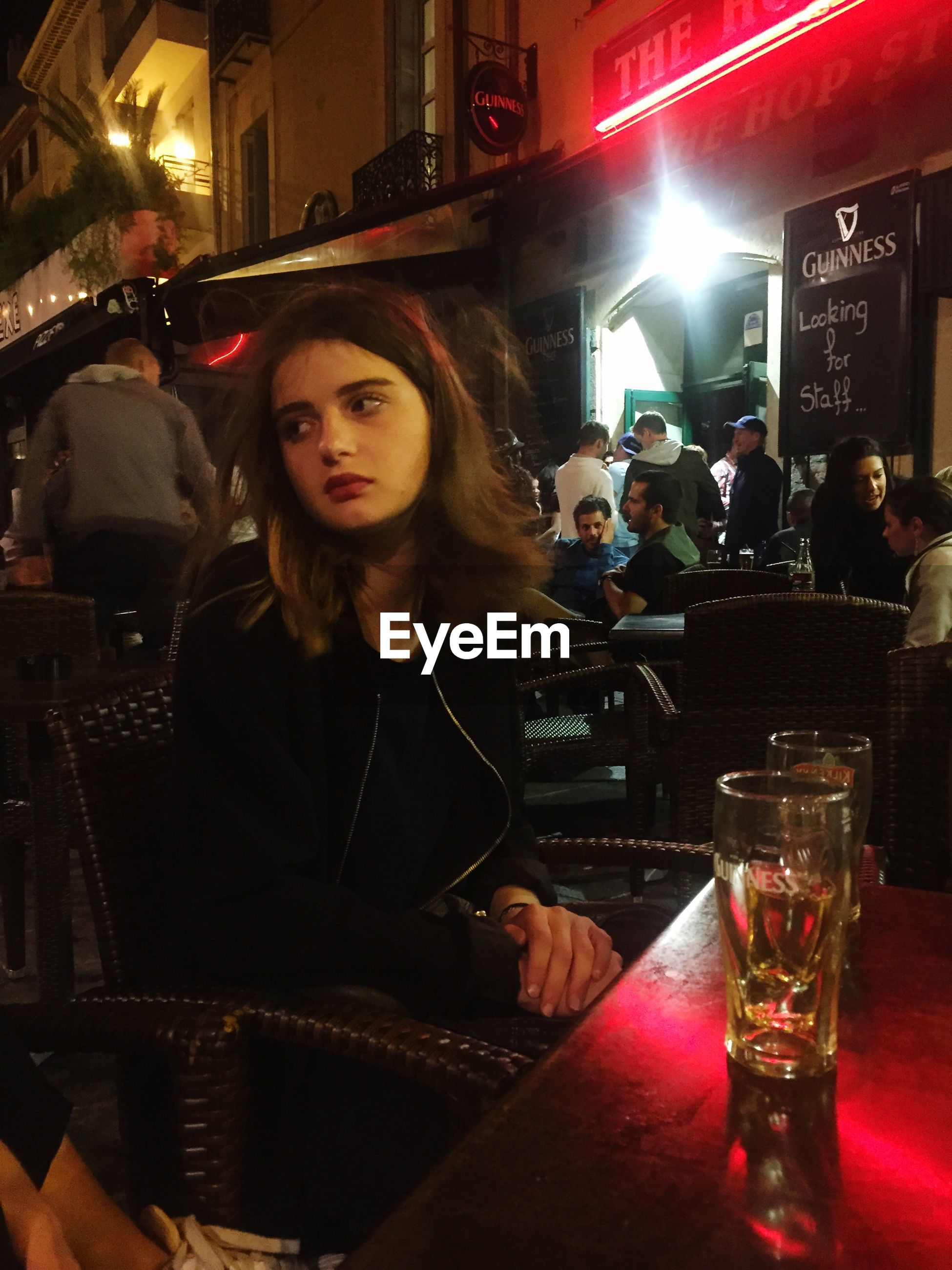 lifestyles, leisure activity, young adult, person, young women, illuminated, casual clothing, front view, sitting, food and drink, portrait, looking at camera, drink, restaurant, togetherness, indoors, night, happiness