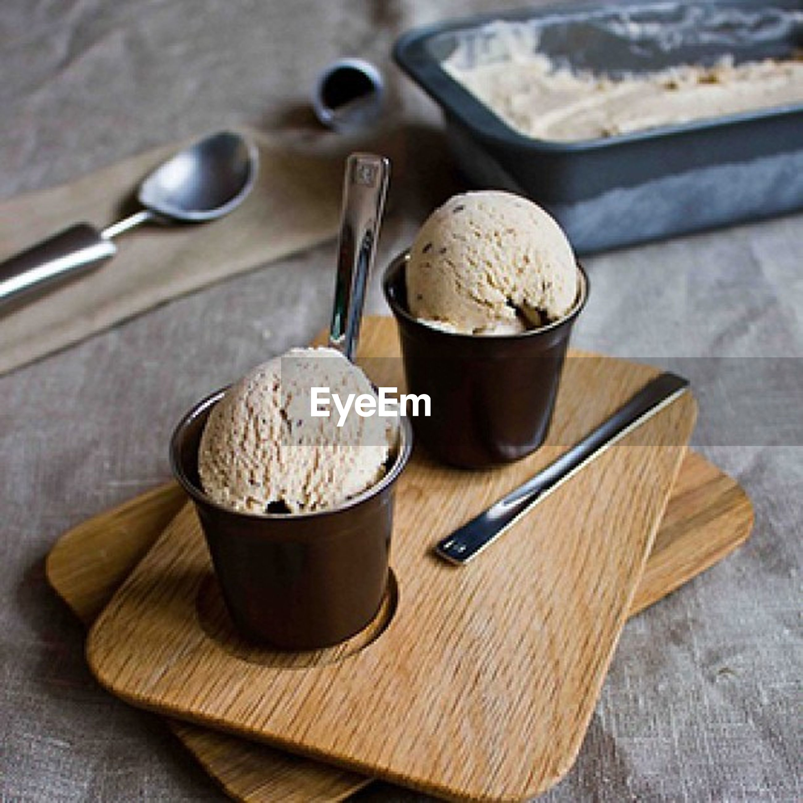 food and drink, drink, freshness, table, indoors, coffee cup, still life, refreshment, coffee - drink, spoon, saucer, food, coffee, close-up, breakfast, cup, healthy eating, high angle view, beverage, wood - material