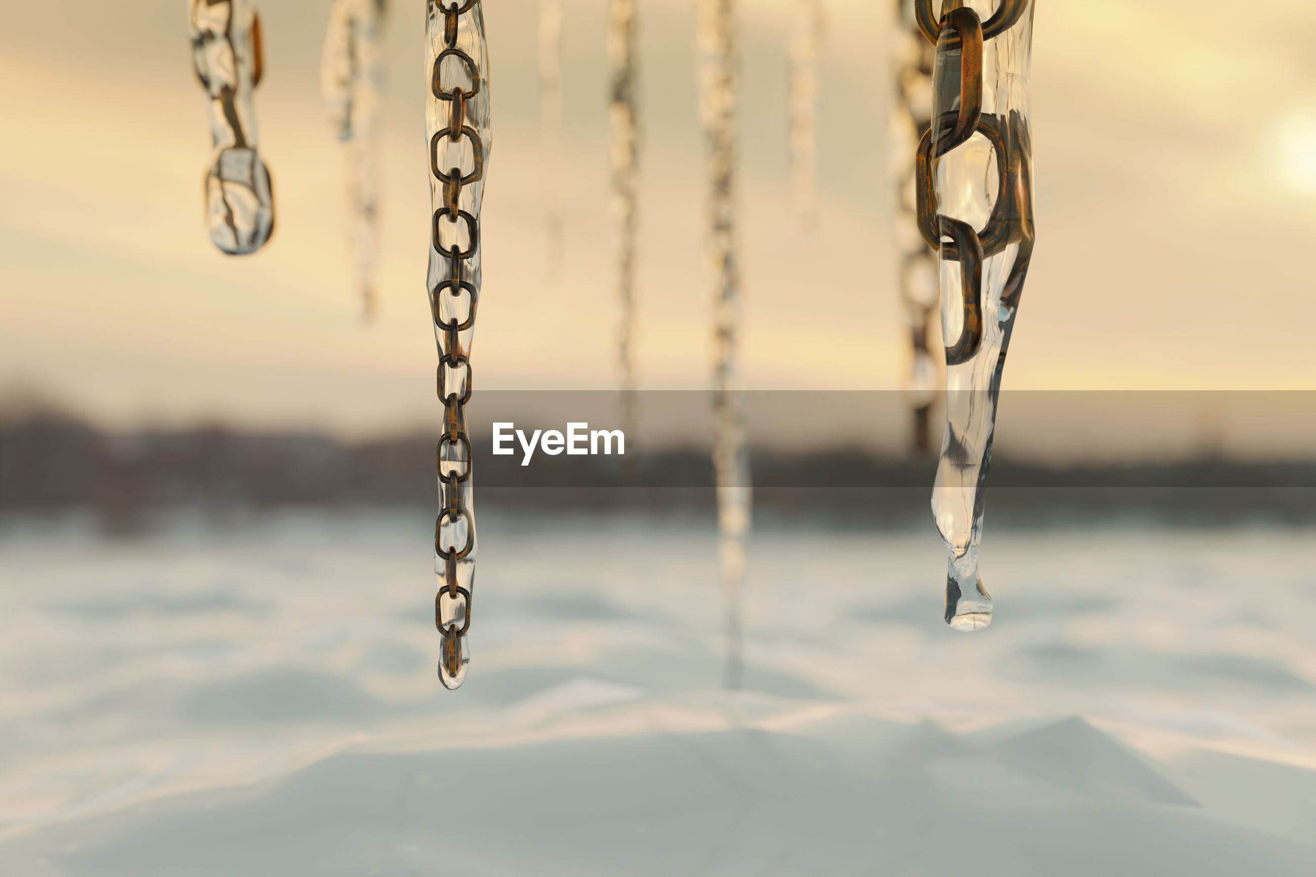 CLOSE-UP OF SWING HANGING ON WATER