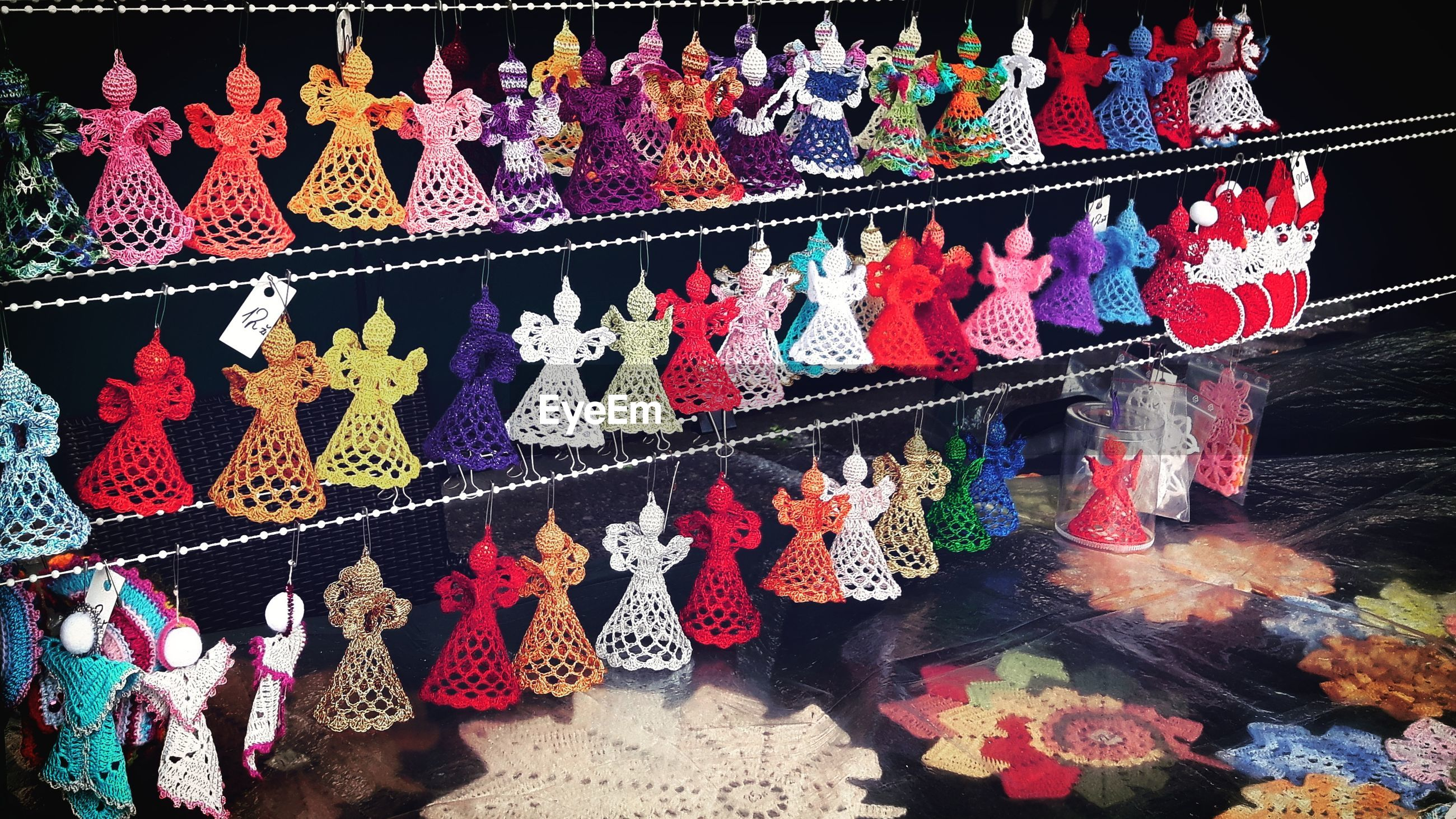 Colorful figurines hanging at market stall
