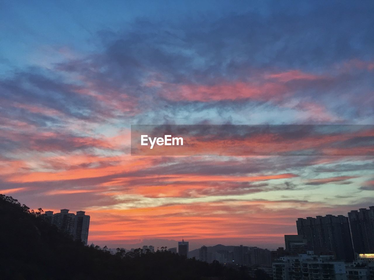 architecture, building exterior, built structure, sunset, skyscraper, city, cityscape, sky, no people, urban skyline, outdoors, modern, tree, nature, day