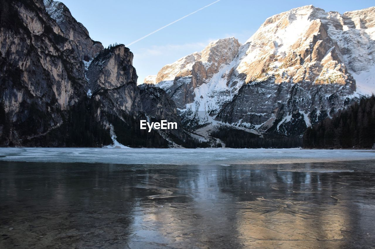 Scenic Of Frozen Lake With Dolomites Against Sky