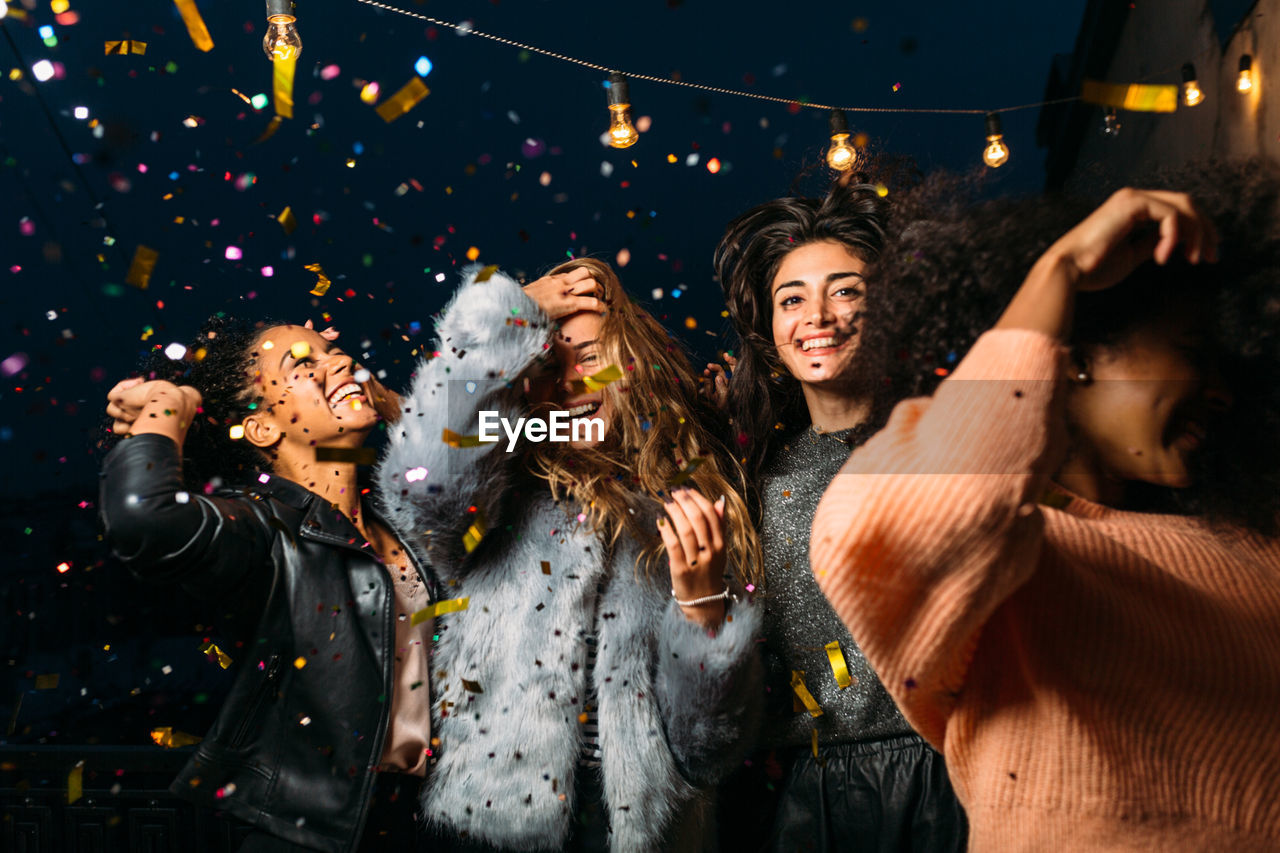 Young Female Friends Enjoying Party At Night