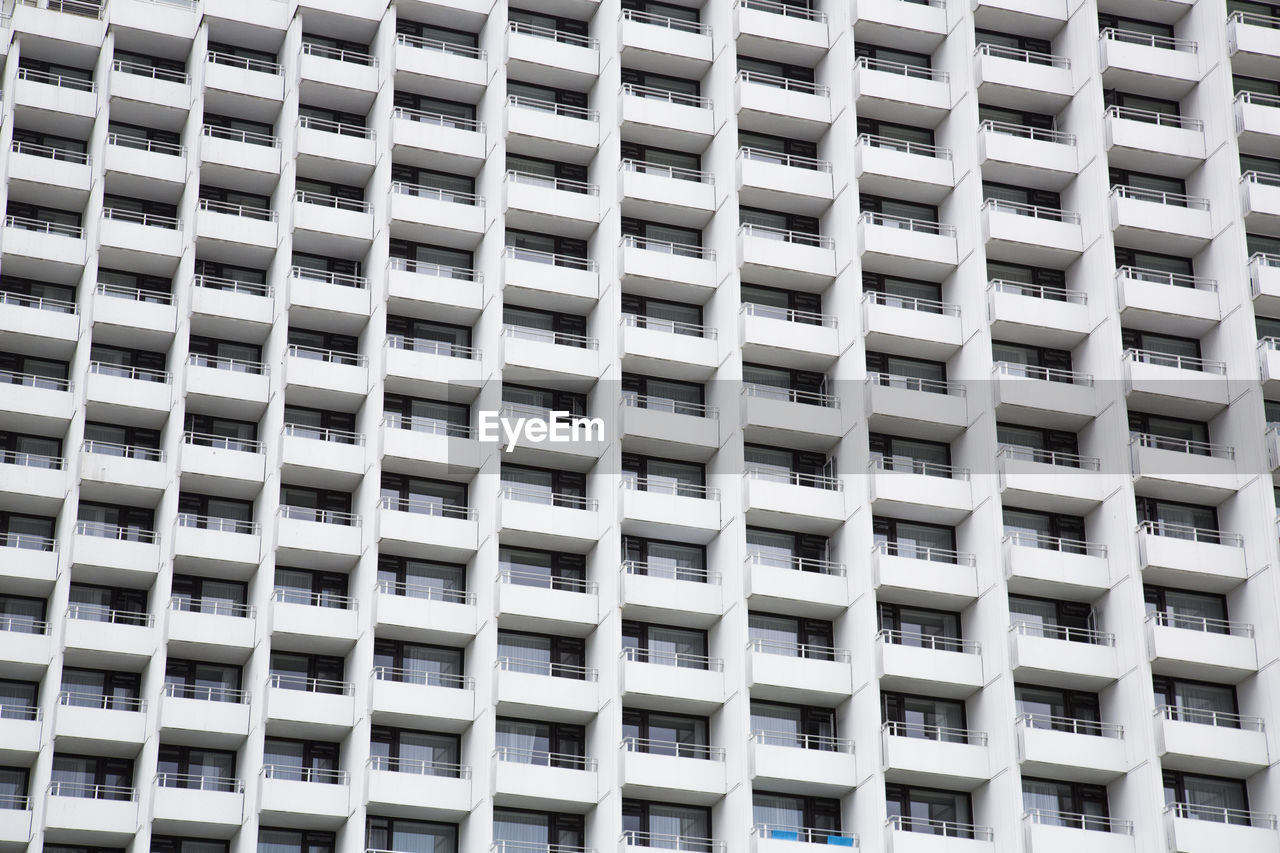 full frame, built structure, architecture, pattern, building exterior, backgrounds, repetition, city, no people, outdoors, building, modern, in a row, day, window, design, low angle view, apartment, office, side by side