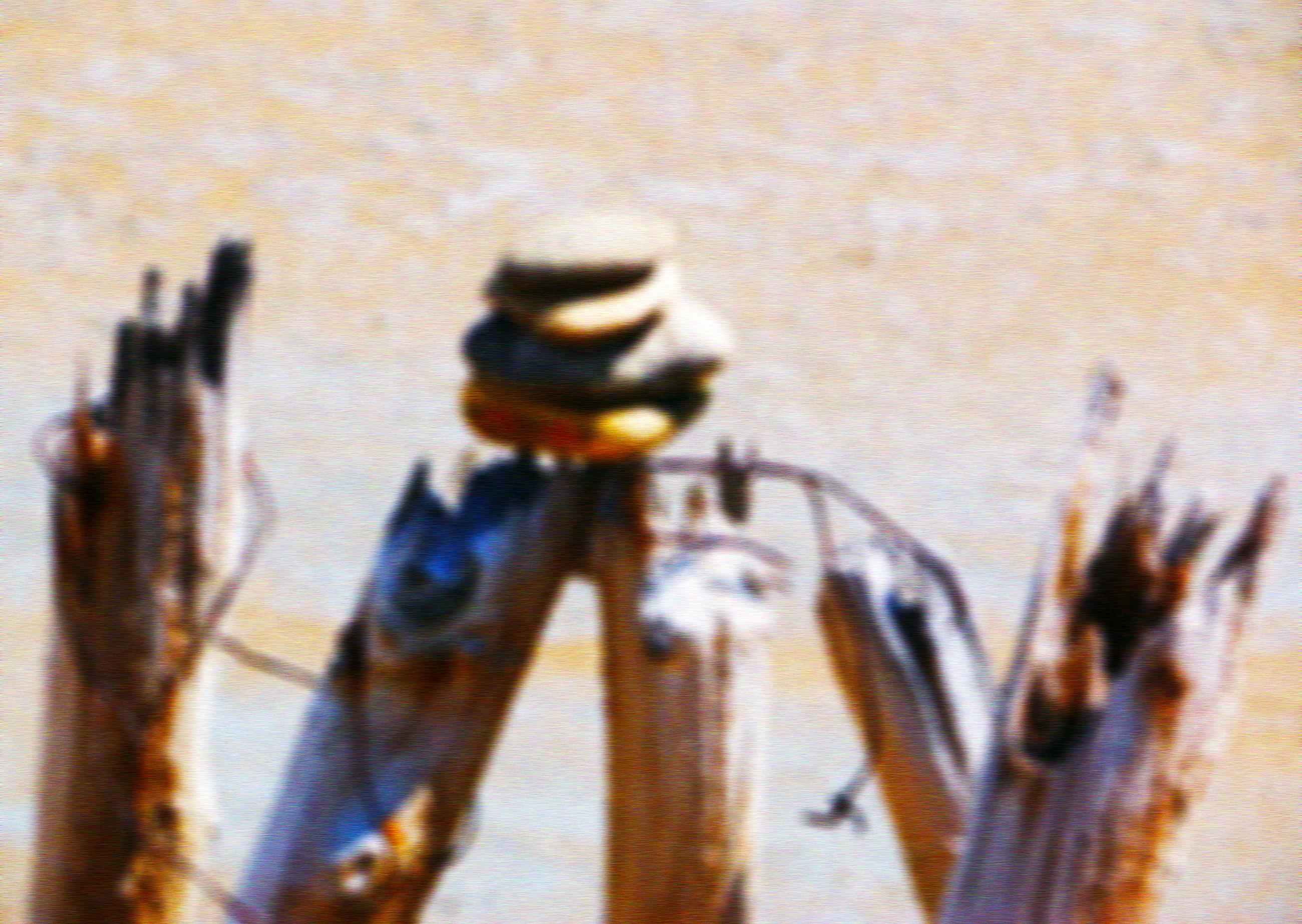 Defocused image of pebbles on wooden posts