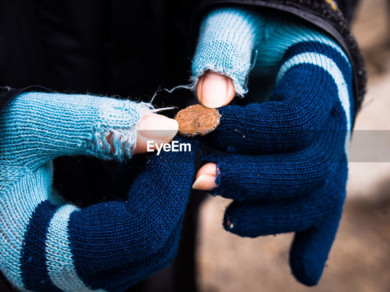 Midsection Of Woman Holding Penny