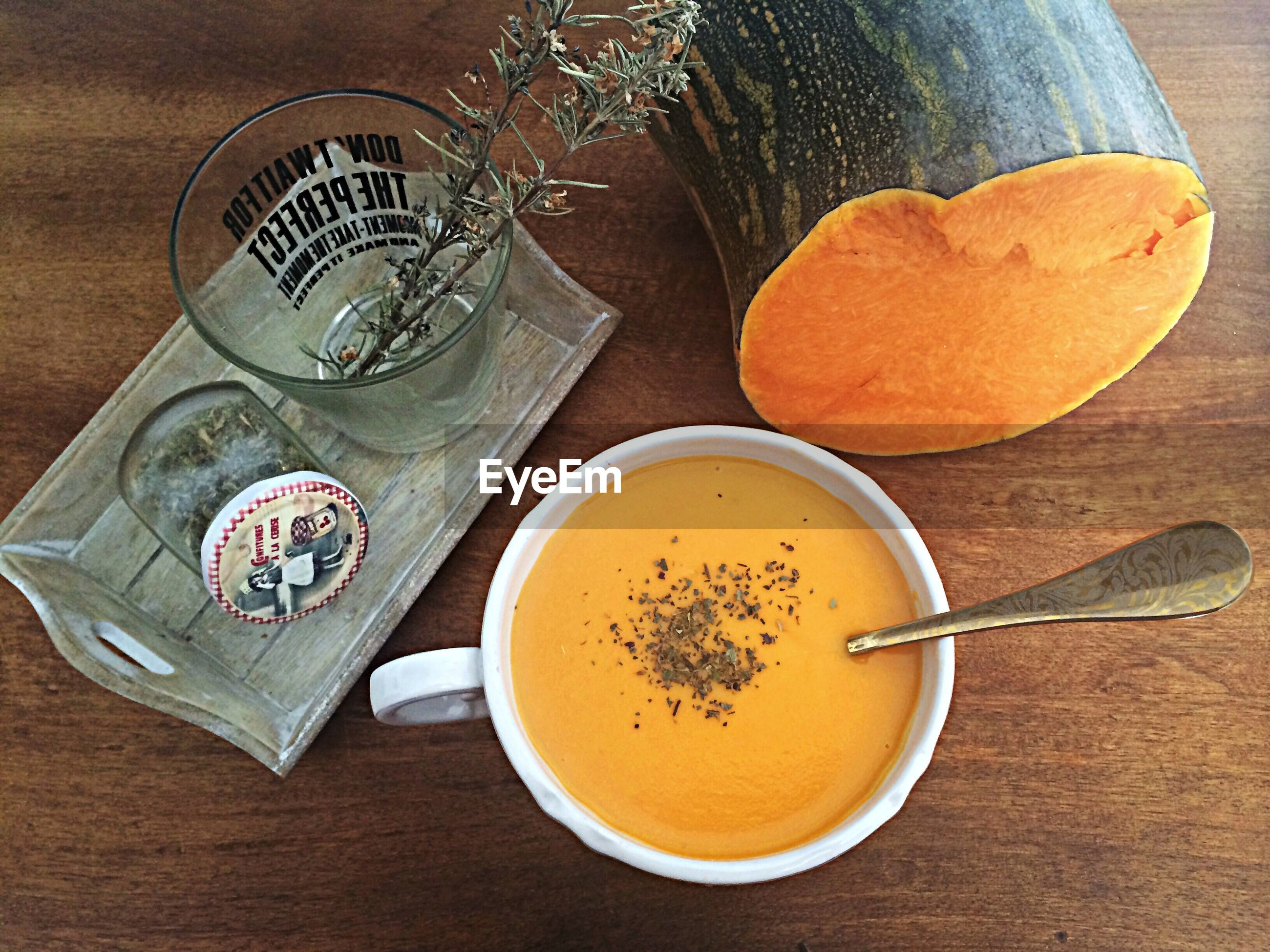 indoors, table, food and drink, drink, still life, refreshment, freshness, coffee cup, high angle view, coffee - drink, spoon, food, drinking glass, plate, healthy eating, directly above, cup, bowl, coffee, fork