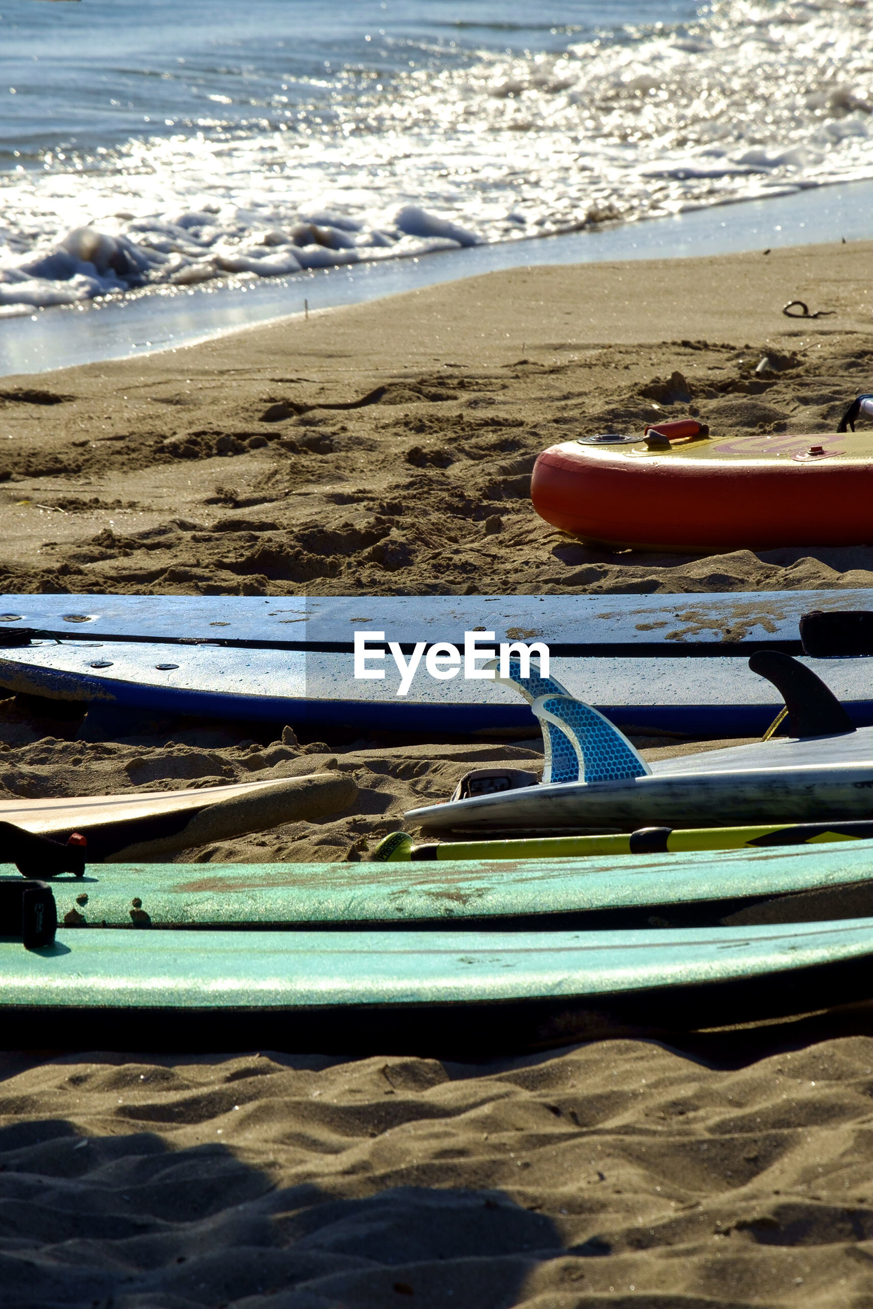 Surfboards on shore at beach