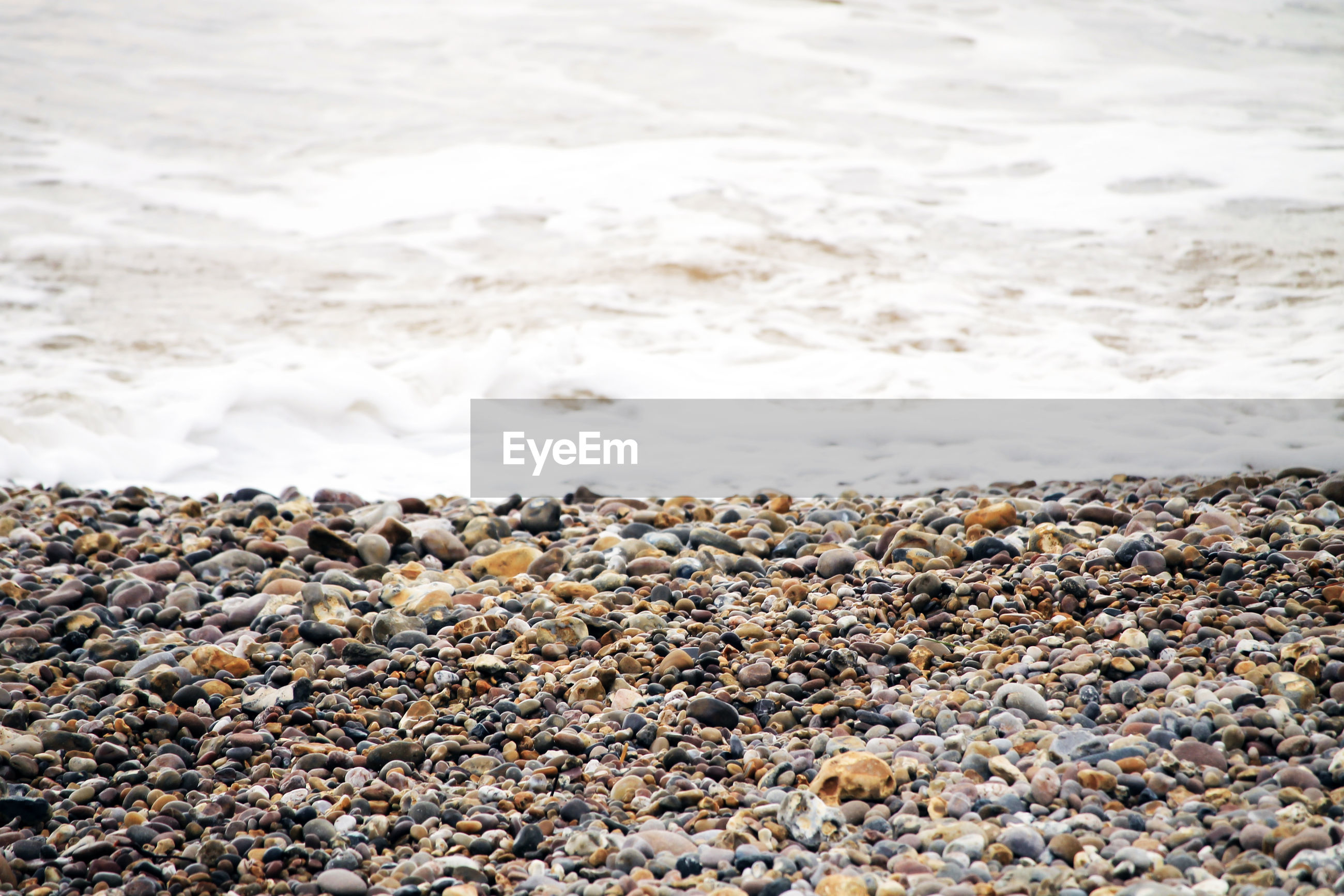 VIEW OF PEBBLES ON BEACH