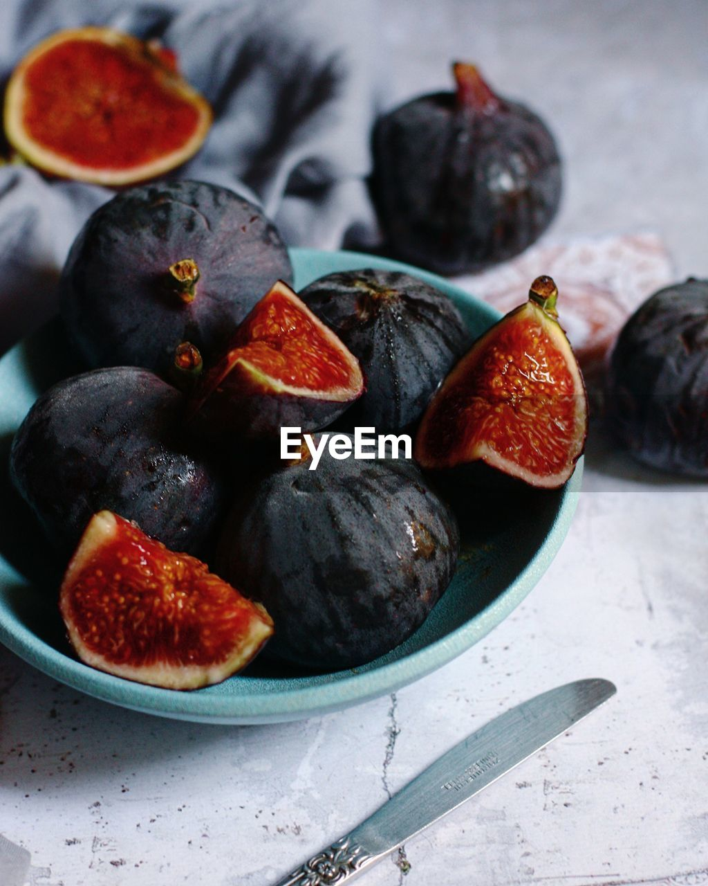 Close-Up Of Figs In Bowl On Table