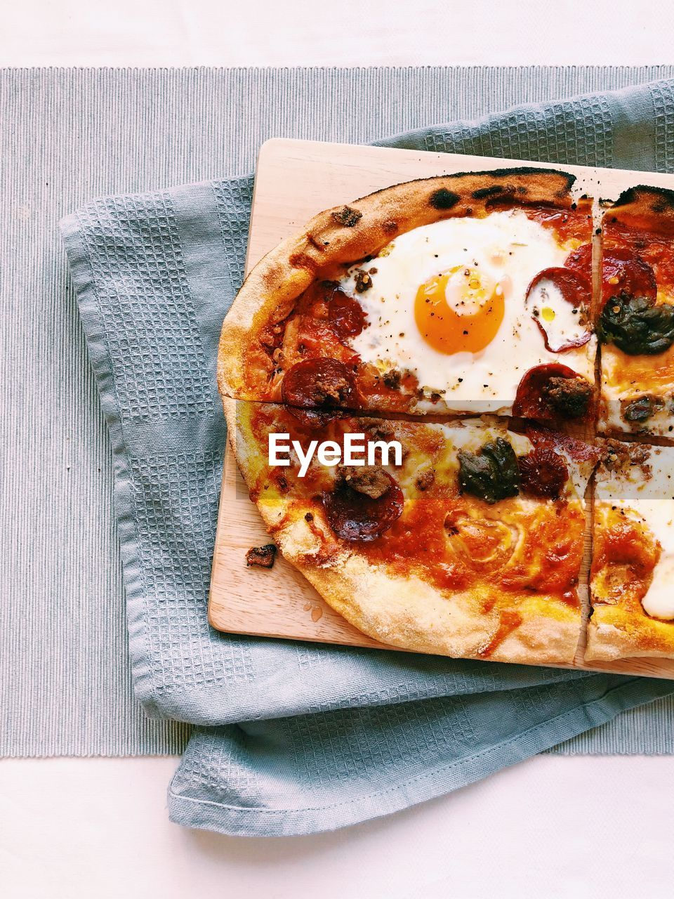 food, ready-to-eat, food and drink, freshness, table, still life, directly above, indoors, close-up, no people, unhealthy eating, napkin, high angle view, dairy product, plate, indulgence, pizza, vegetable, tomato, temptation