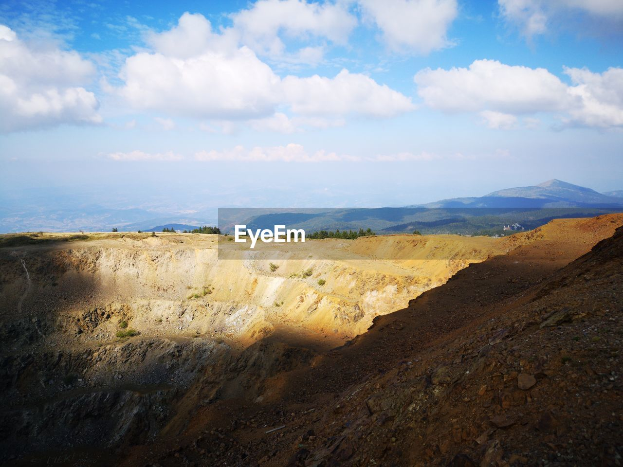 cloud - sky, sky, environment, beauty in nature, landscape, scenics - nature, tranquility, tranquil scene, nature, mountain, non-urban scene, no people, land, day, rock, remote, outdoors, geology, idyllic, rock - object, climate, arid climate, eroded