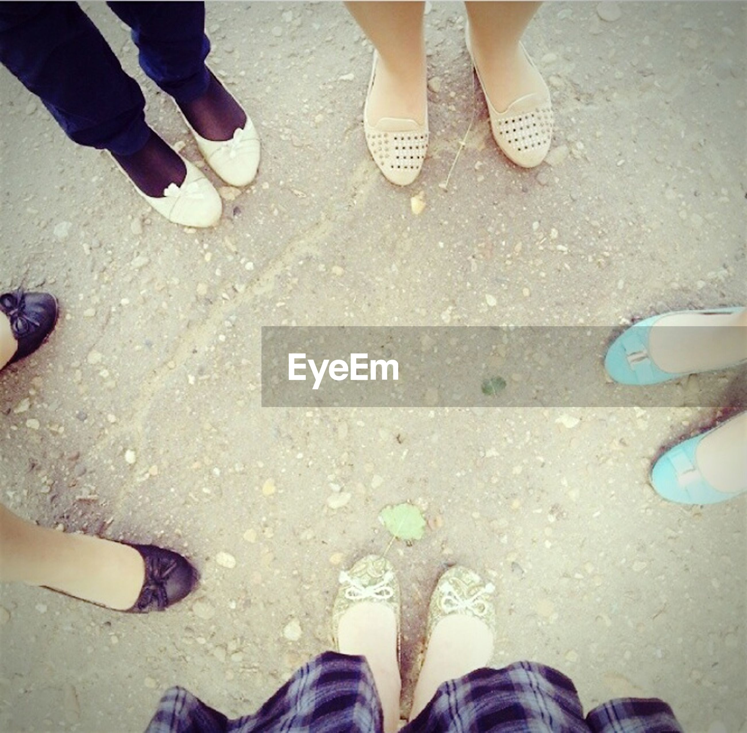 low section, person, lifestyles, togetherness, human foot, shoe, standing, leisure activity, beach, friendship, bonding, men, footwear, high angle view