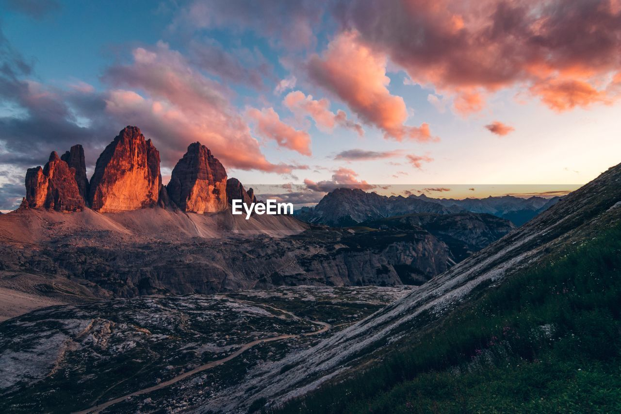 sky, cloud - sky, beauty in nature, tranquil scene, scenics - nature, environment, sunset, landscape, tranquility, nature, mountain, non-urban scene, idyllic, rock, mountain range, no people, rock - object, rock formation, land, remote, outdoors, formation, eroded, mountain peak