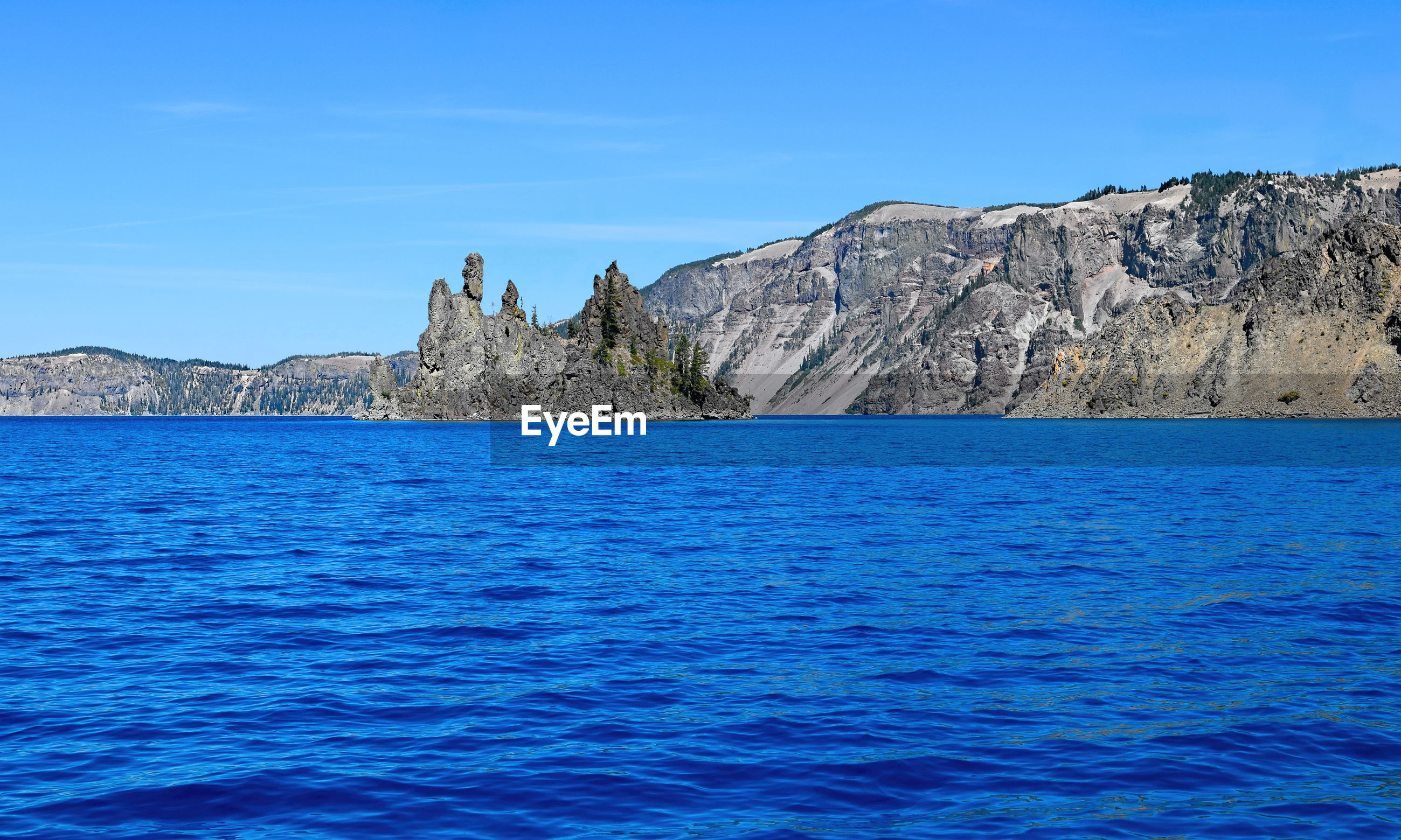 SCENIC VIEW OF SEA AND ROCK FORMATION AGAINST BLUE SKY
