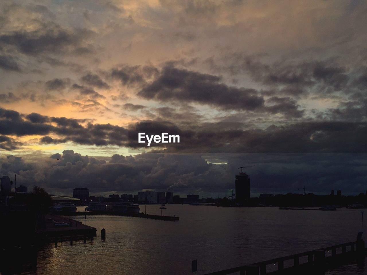 sky, cloud - sky, built structure, sunset, water, no people, architecture, building exterior, city, outdoors, travel destinations, nature, scenics, beauty in nature, nautical vessel, cityscape, day