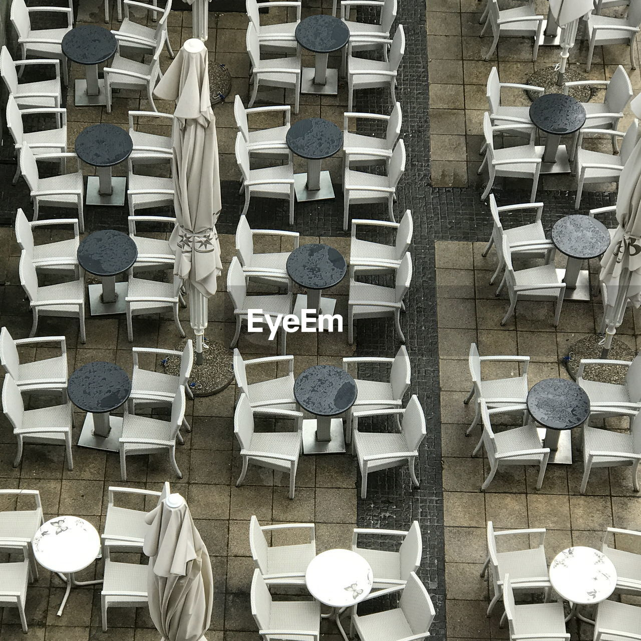 High Angle View Of Chairs And Tables Arranged Outdoors
