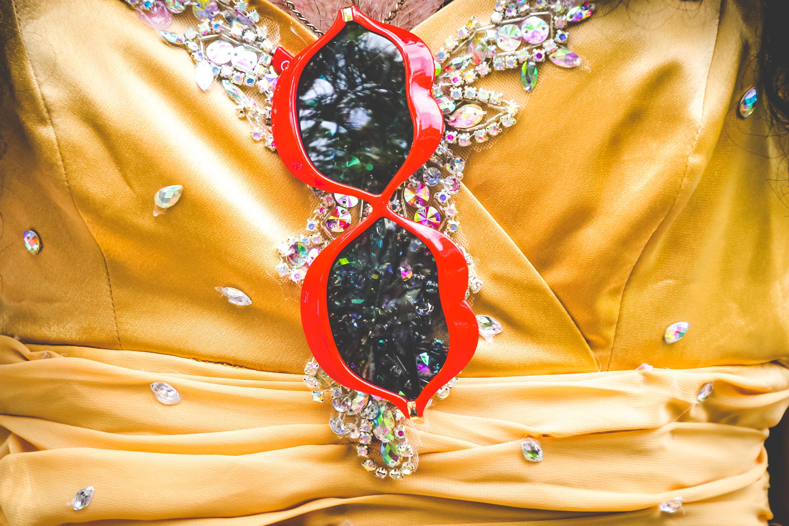 Close-up of sunglasses on dress