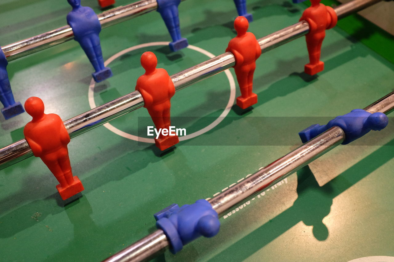 leisure games, representation, sport, human representation, male likeness, relaxation, leisure activity, figurine, team sport, soccer, teamwork, high angle view, competition, cooperation, no people, close-up, metal, blue, toy, table