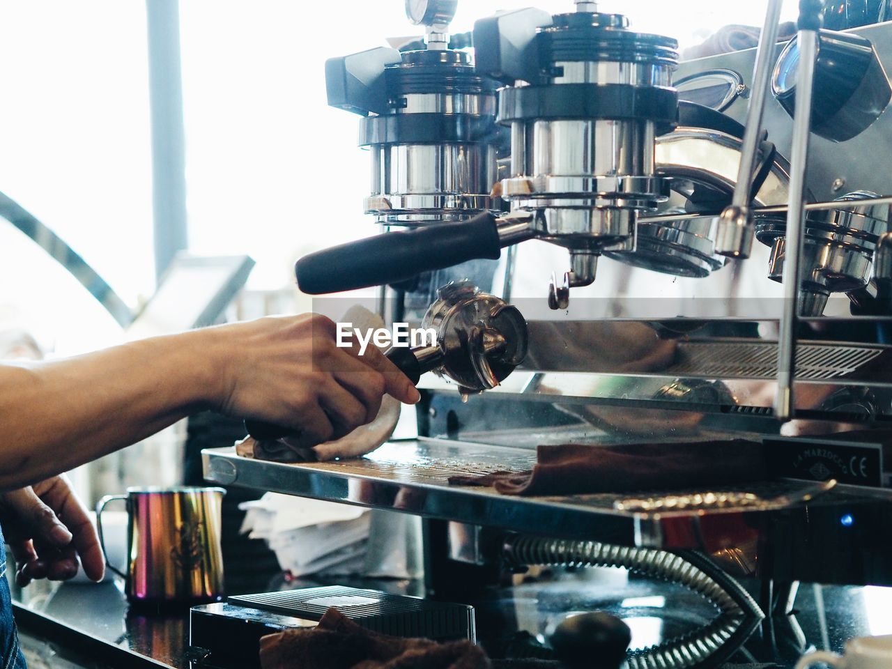 Cropped Hand Cleaning Espresso Maker
