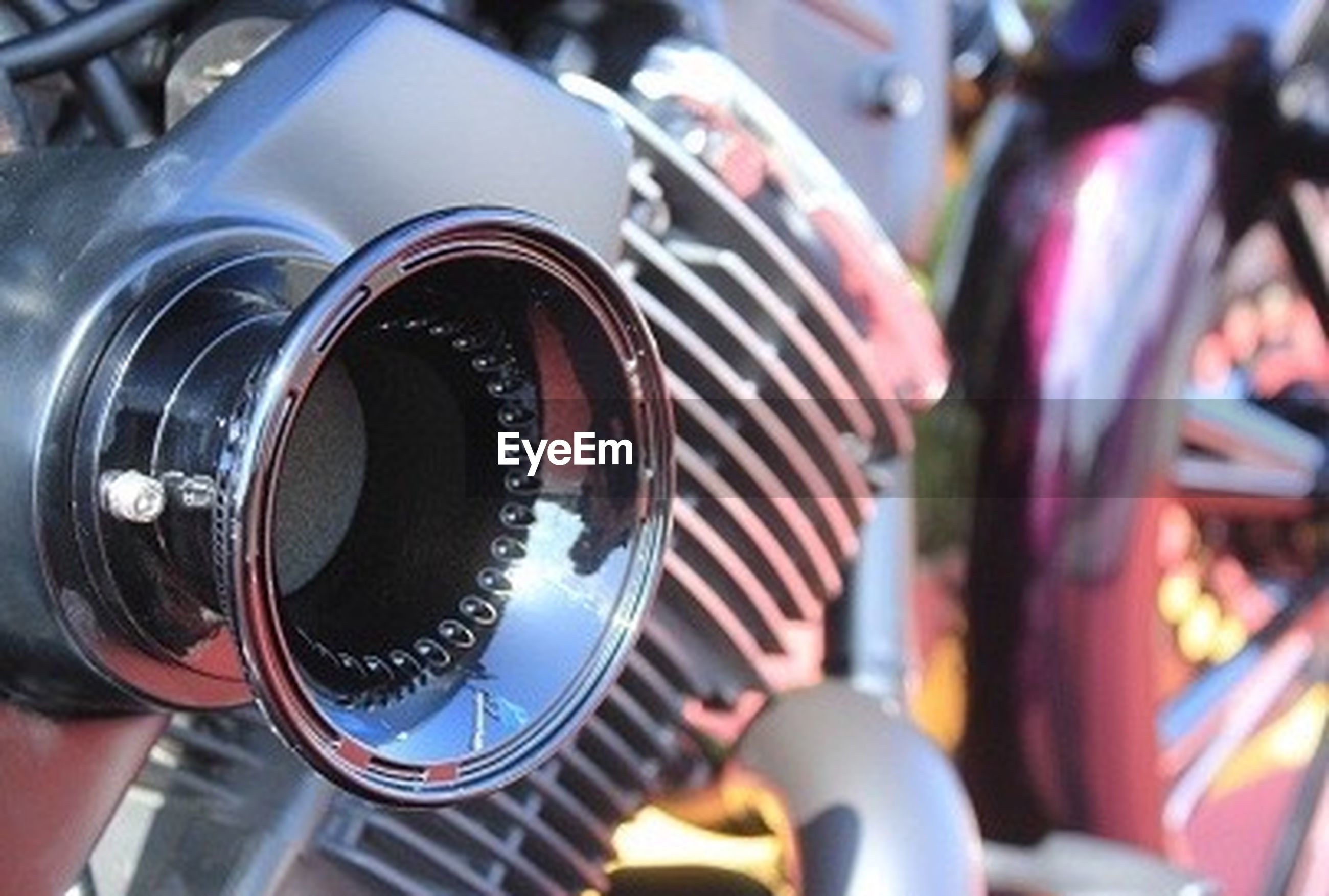 focus on foreground, close-up, land vehicle, selective focus, part of, mode of transport, transportation, technology, indoors, car, cropped, metal, photography themes, music, incidental people, day, travel, equipment, camera - photographic equipment