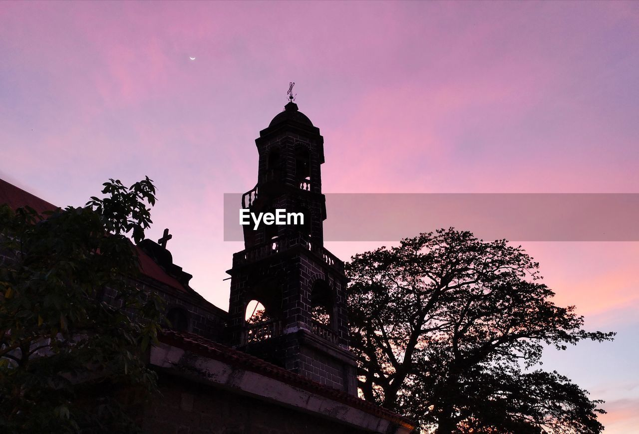 sky, built structure, architecture, building exterior, low angle view, religion, belief, tree, place of worship, building, spirituality, plant, no people, nature, tower, sunset, history, dusk, outdoors, spire, purple