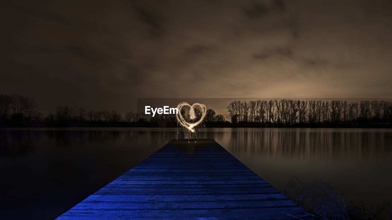 Heart Shape Light Painting At Lakeshore During Night
