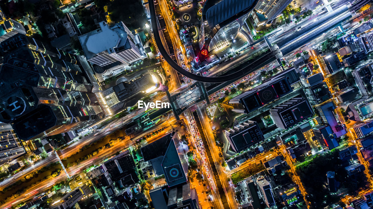 city, building exterior, city life, architecture, illuminated, road, street, cityscape, night, city street, built structure, transportation, aerial view, office building exterior, high angle view, building, residential district, travel destinations, traffic, crowded, modern, skyscraper, outdoors