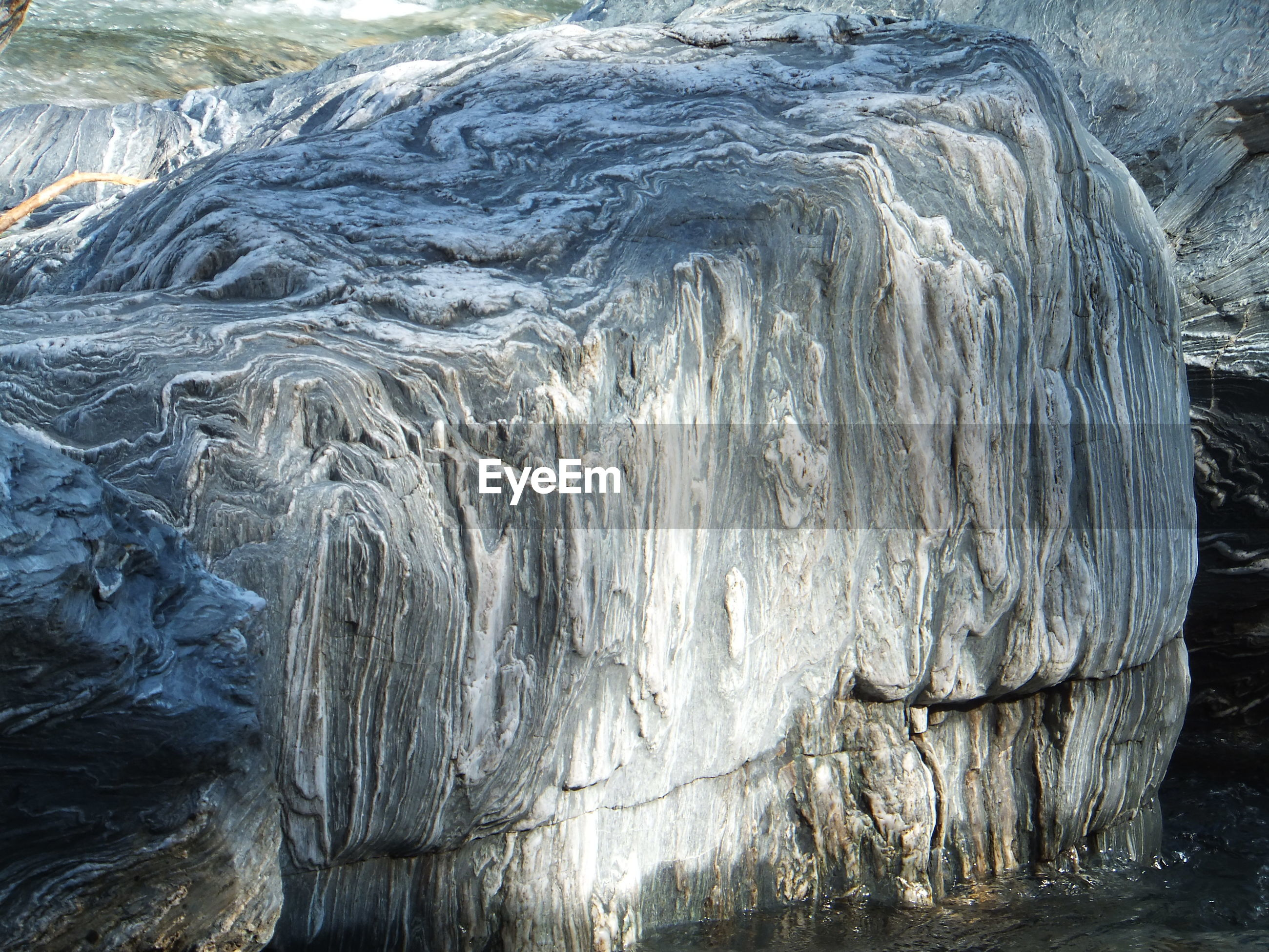 Close-up of rock formation on lake