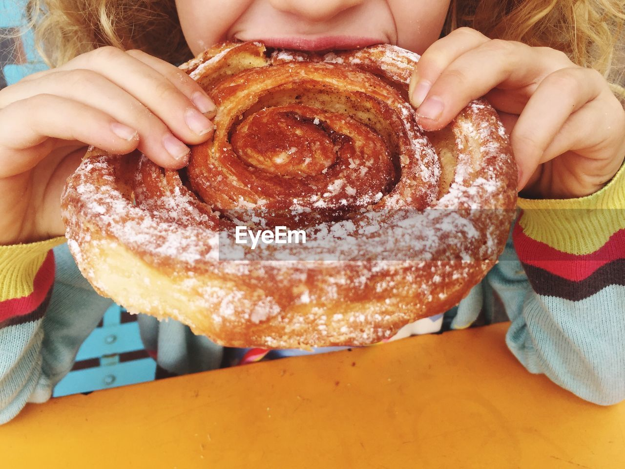 Close-Up Of Girl Eating Pastry