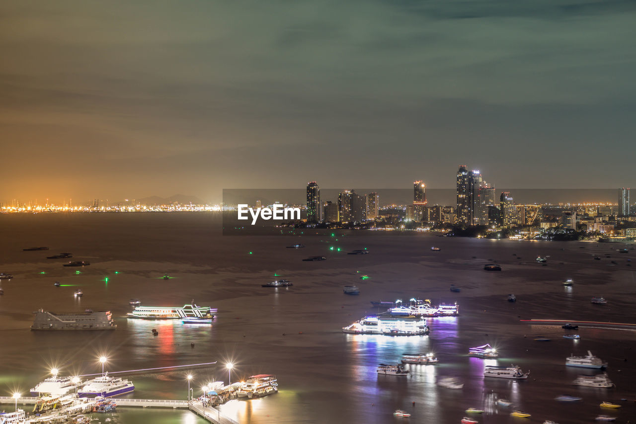 architecture, building exterior, illuminated, water, city, sky, built structure, night, cityscape, nature, cloud - sky, no people, sea, building, waterfront, high angle view, nautical vessel, transportation, reflection, skyscraper, office building exterior, outdoors, modern, light, bay
