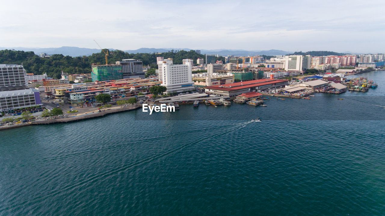 architecture, built structure, building exterior, water, city, building, waterfront, sky, nature, nautical vessel, cityscape, transportation, sea, day, no people, high angle view, residential district, outdoors, mode of transportation, skyscraper, canal