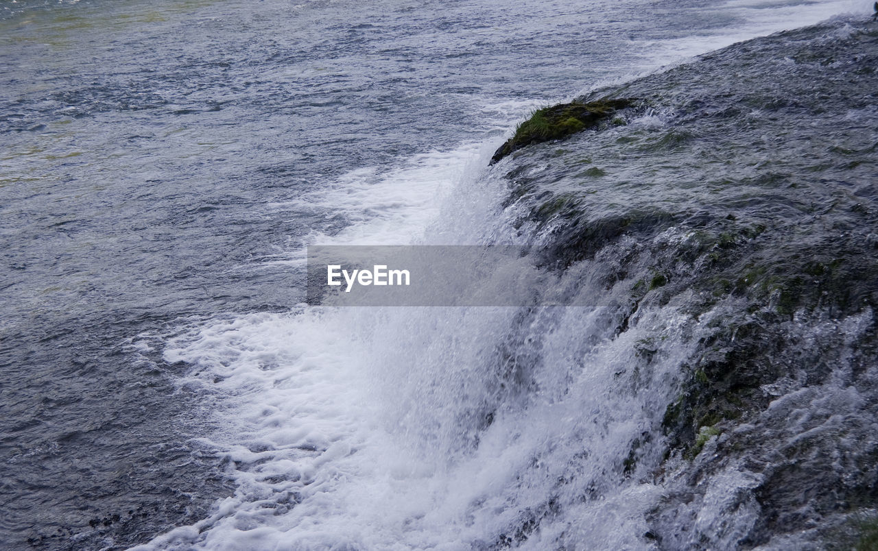 CLOSE-UP OF WAVES ON SEA