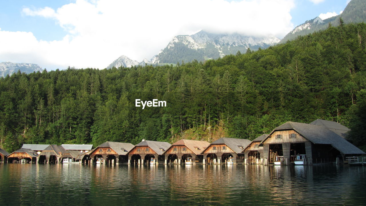 Boathouses In Konigssee Against Trees