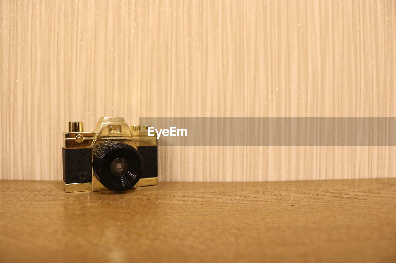 Close-up of old camera on table