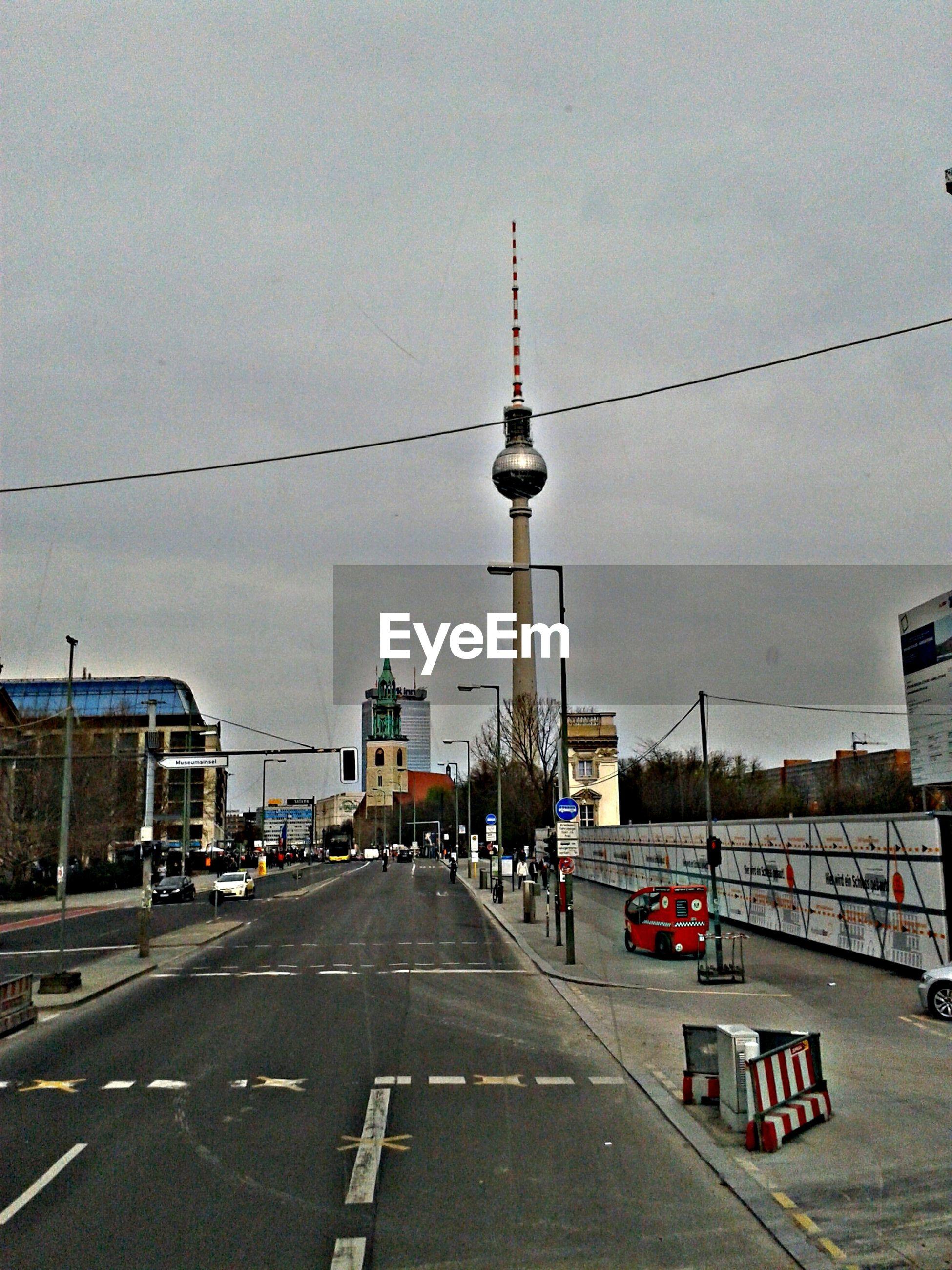 City street leading towards alexanderplatz against sky