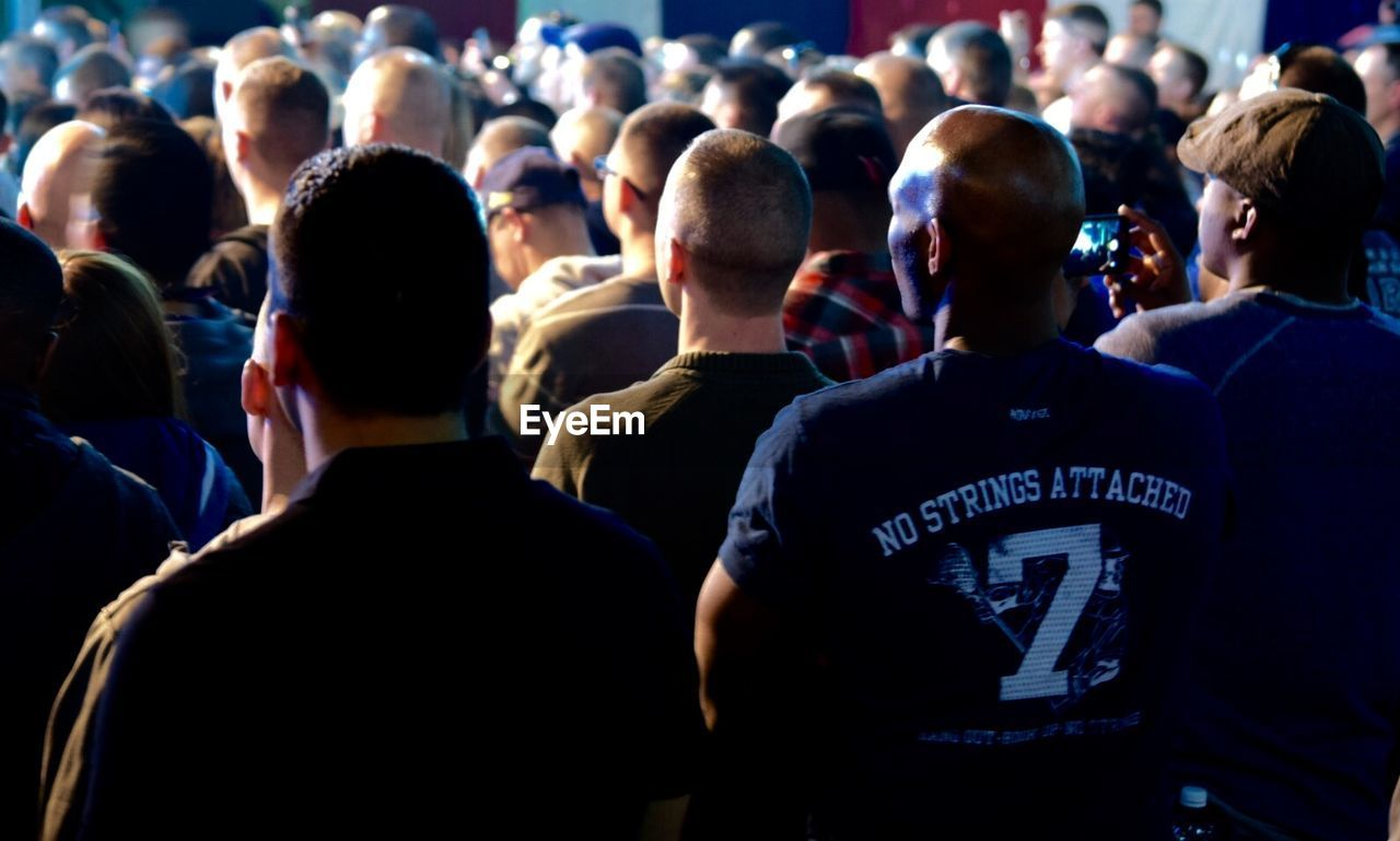 Rear View Of Men Watching Together