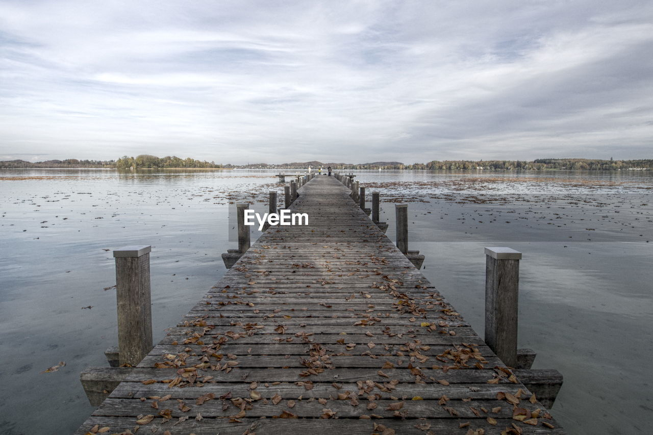 water, pier, diminishing perspective, lake, sky, the way forward, cloud - sky, no people, outdoors, nature, tranquil scene, day, tranquility, jetty, beauty in nature, scenics